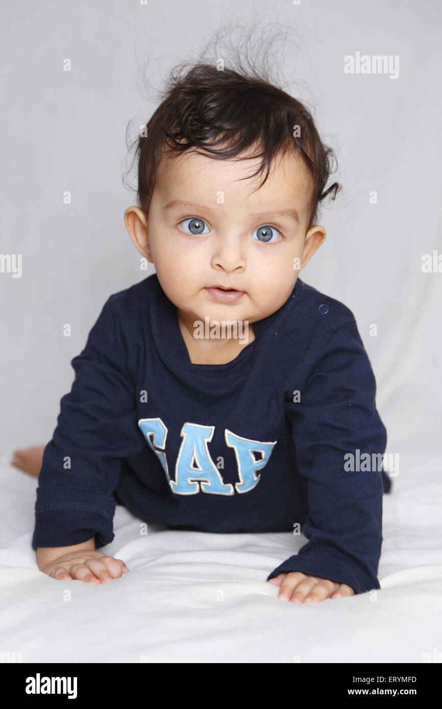 Baby boy on his stomach trying to crawl MR#743W - Stock Image