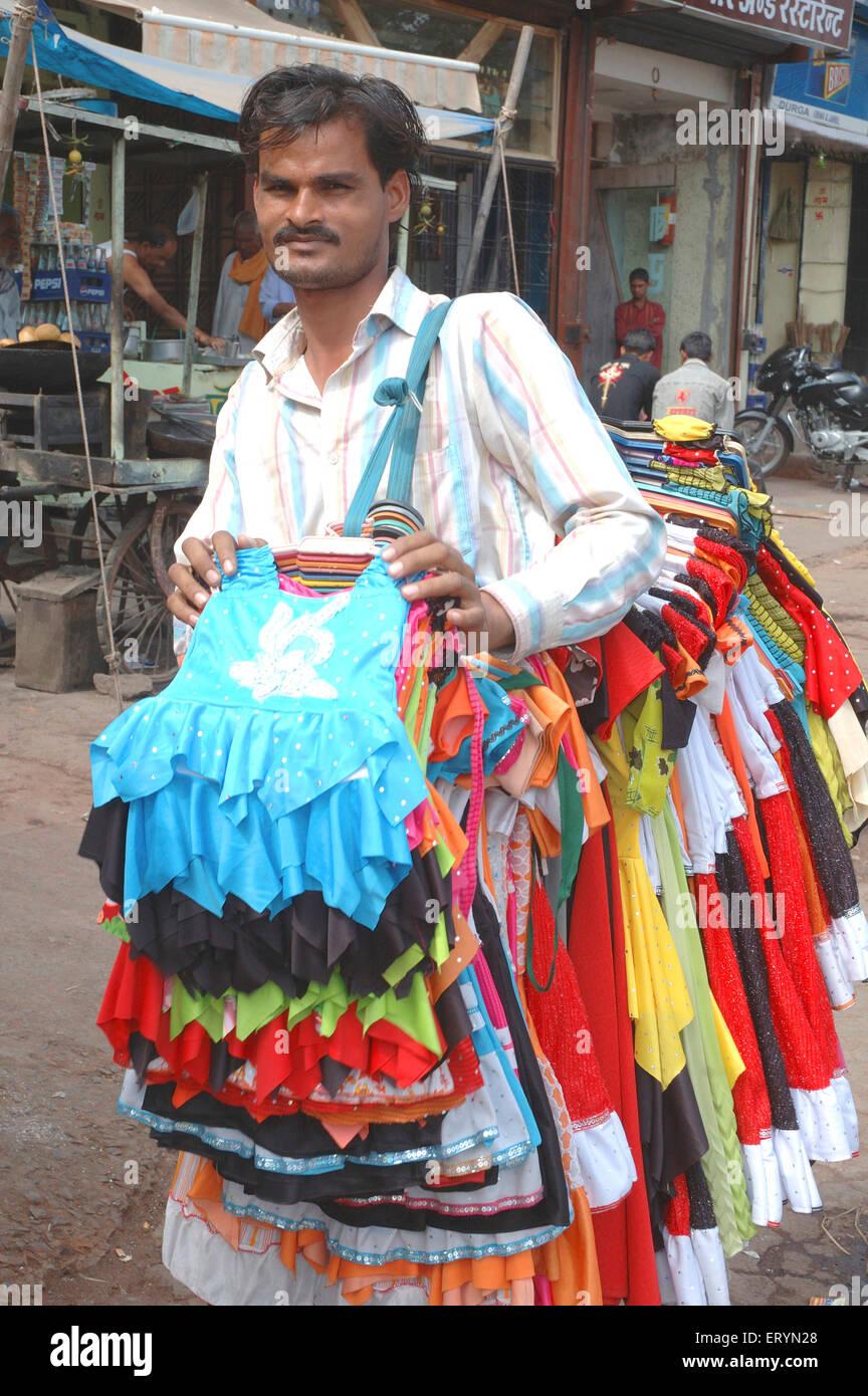 Salesman selling clothes ; Nagpur ; Maharashtra ; India NO MR - Stock Image