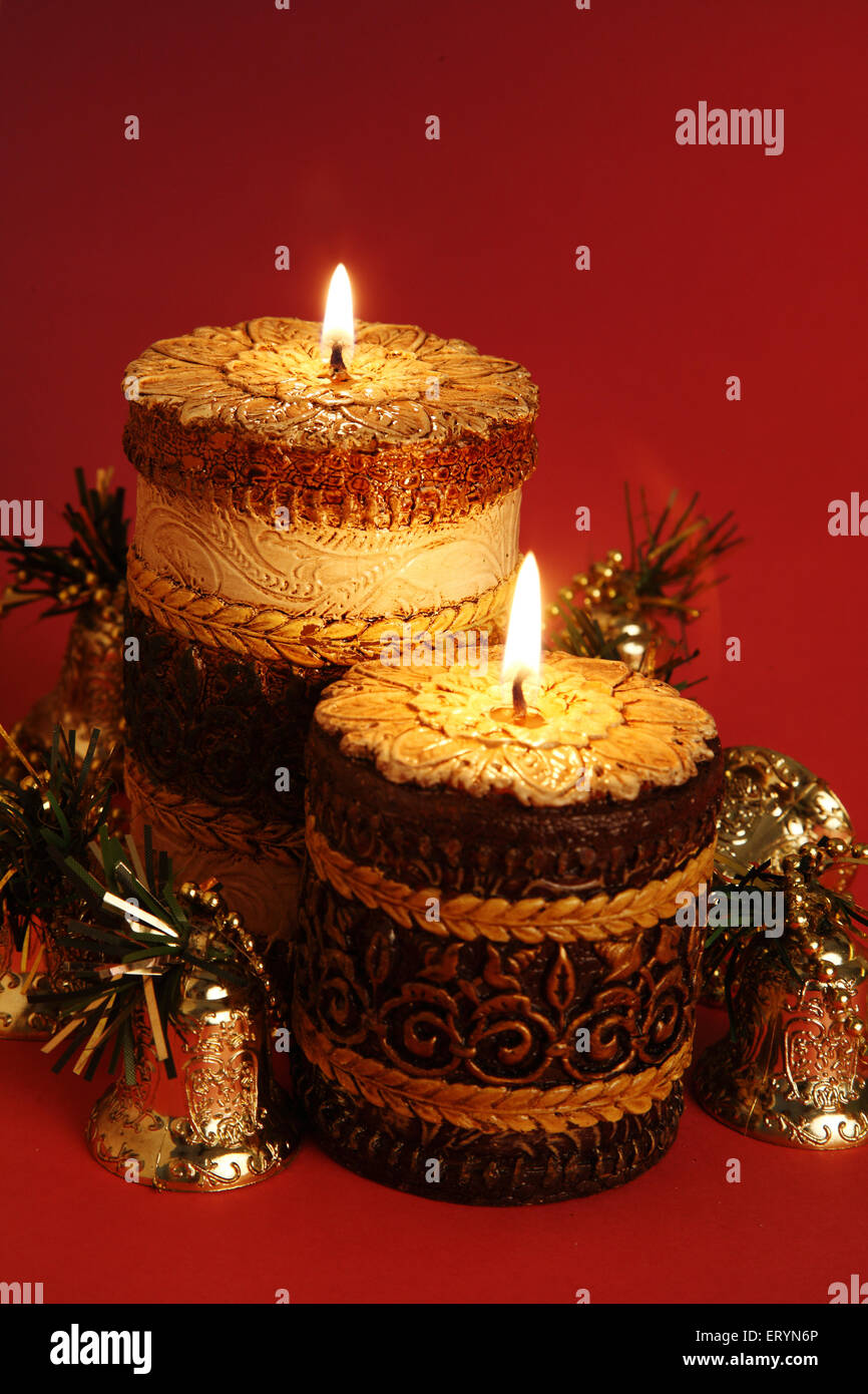Burning candles with bells in Christmas festival - Stock Image