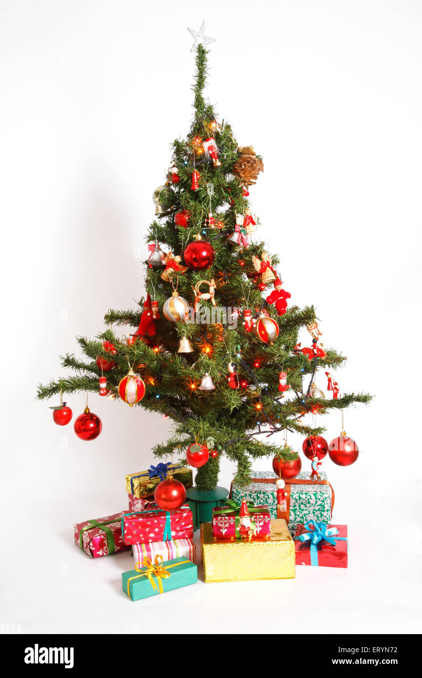 Decorated Christmas tree with gift boxes in Christmas festival - Stock Image