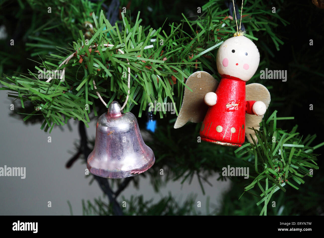 Christmas tree decorated with bell and miniature doll in Christmas festival - Stock Image
