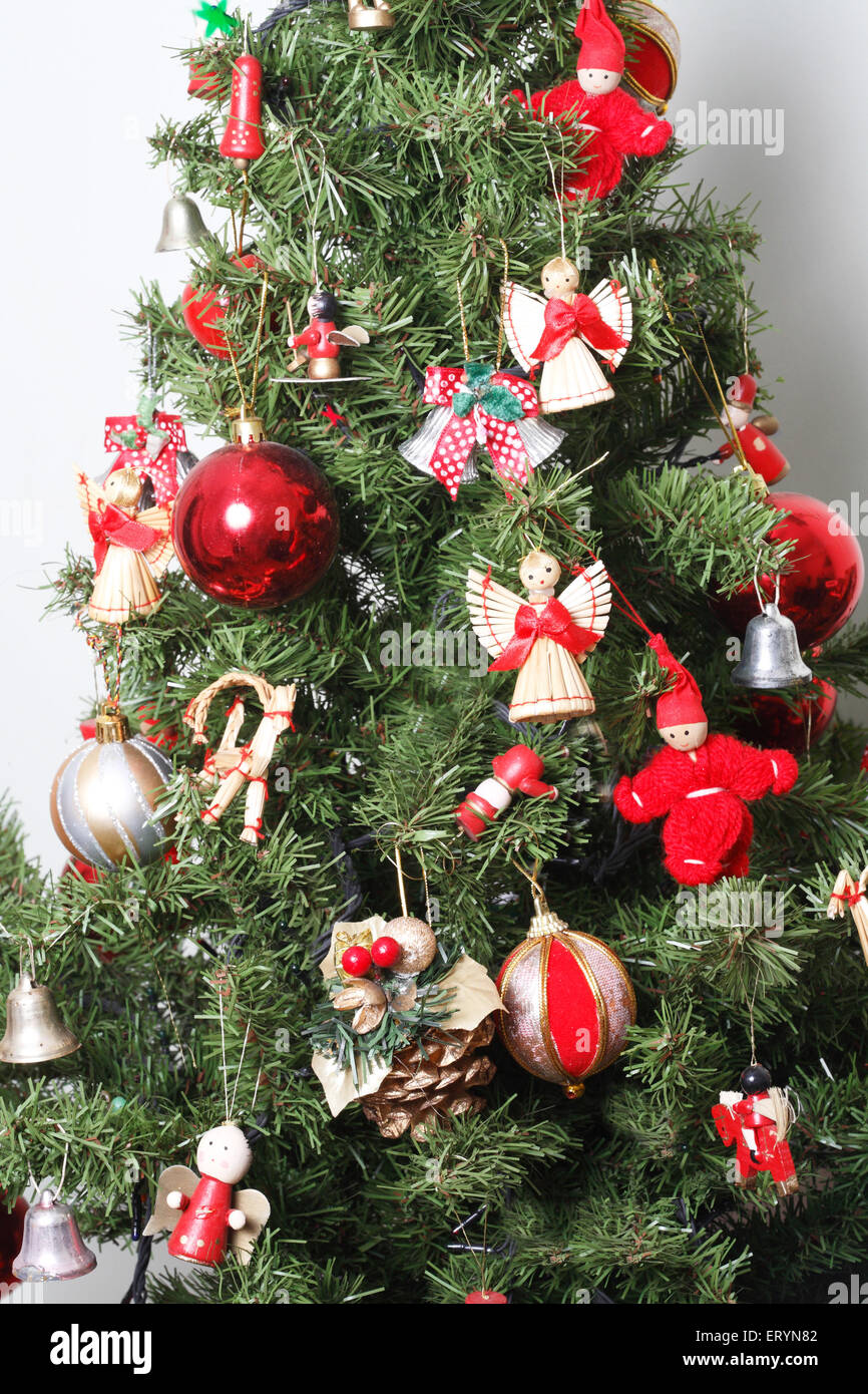 Christmas tree decorated with balls and miniature dolls in Christmas festival - Stock Image