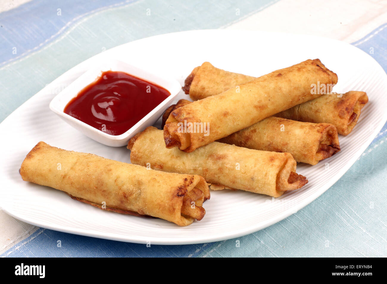 Chinese food Vegetable spring rolls in plate India PR#743AH - Stock Image