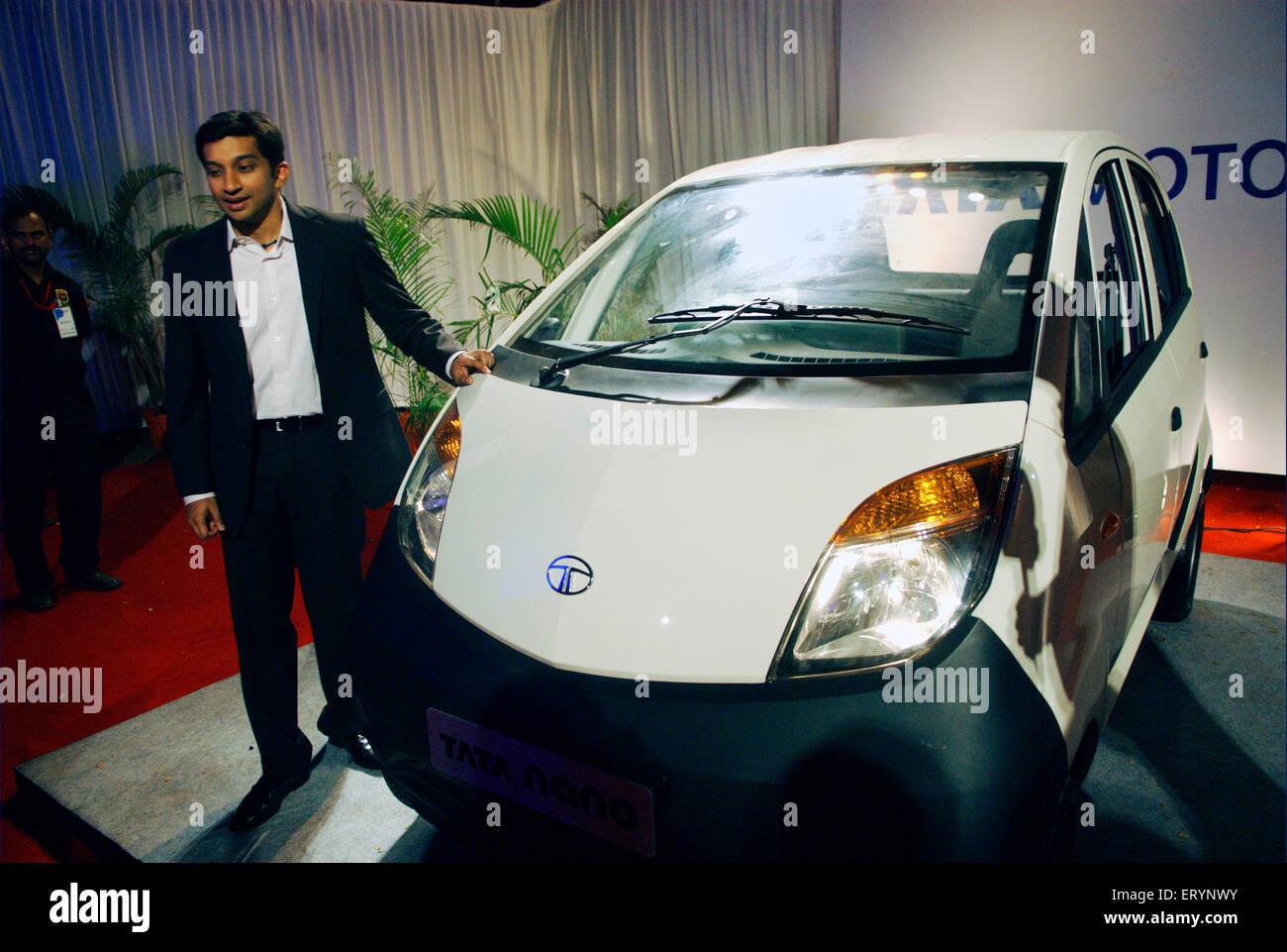 Former Formula driver Narain Karthikeyan with new Tata Nano car ; Bombay Mumbai ; Maharashtra ; India NO MR - Stock Image