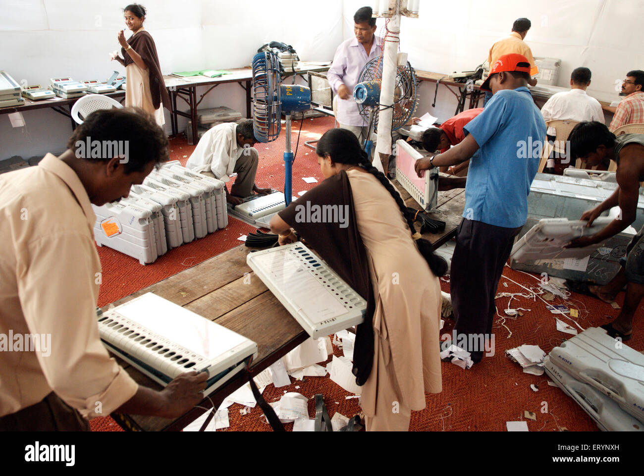 Staff members of Bharat Electronics Limited checking electronic voting machine evm ; Bombay Mumbai ; Maharashtra - Stock Image