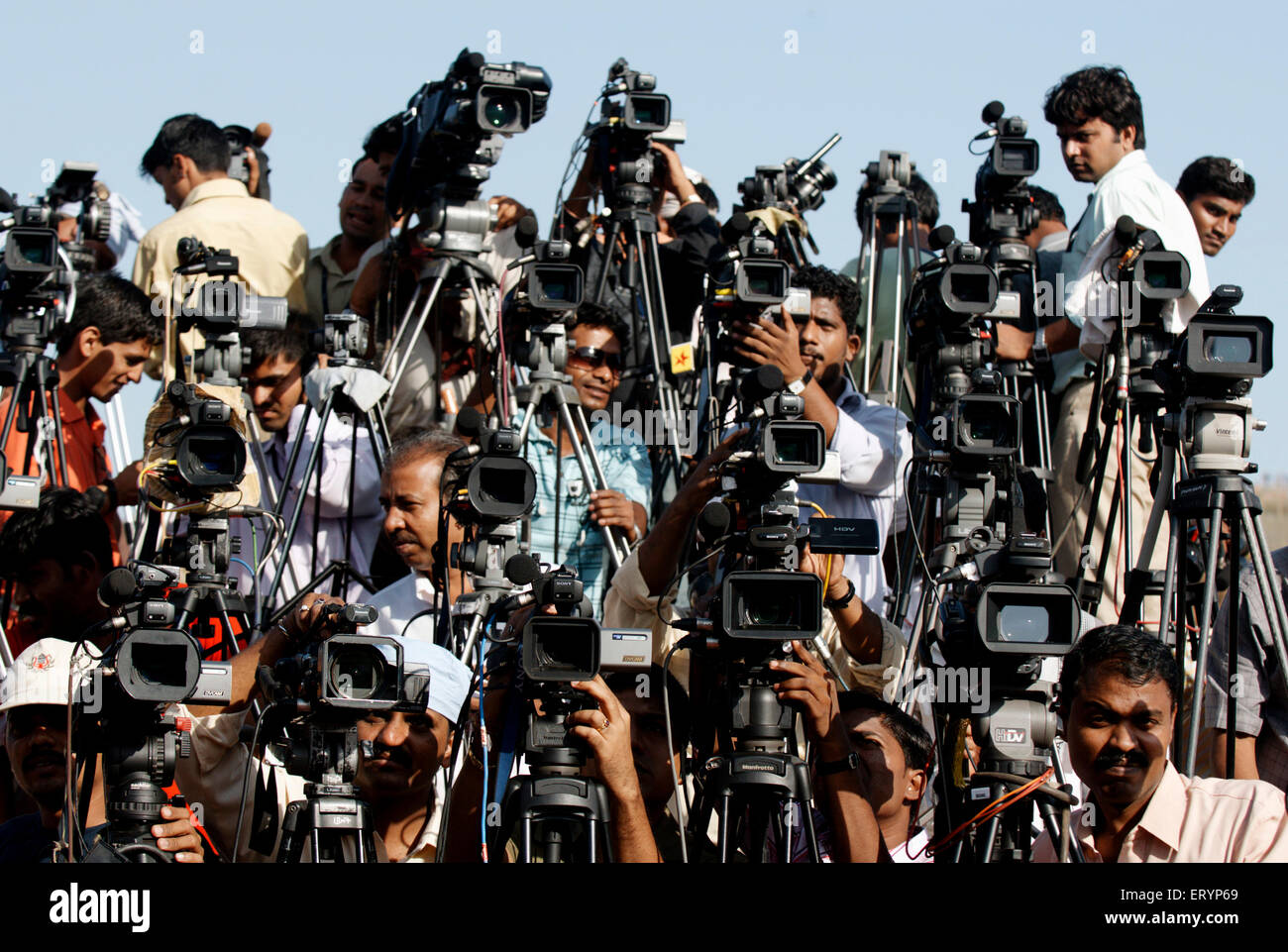 Cameramen representing different news channels electronic media during political rally ; Bombay Mumbai - Stock Image