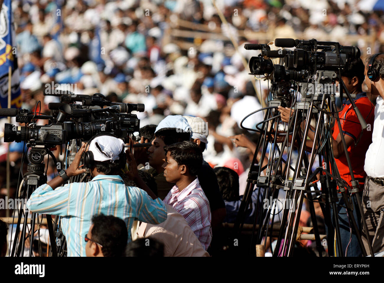 Cameramen representing different news channels electronic media election campaign rally ; Bombay - Stock Image