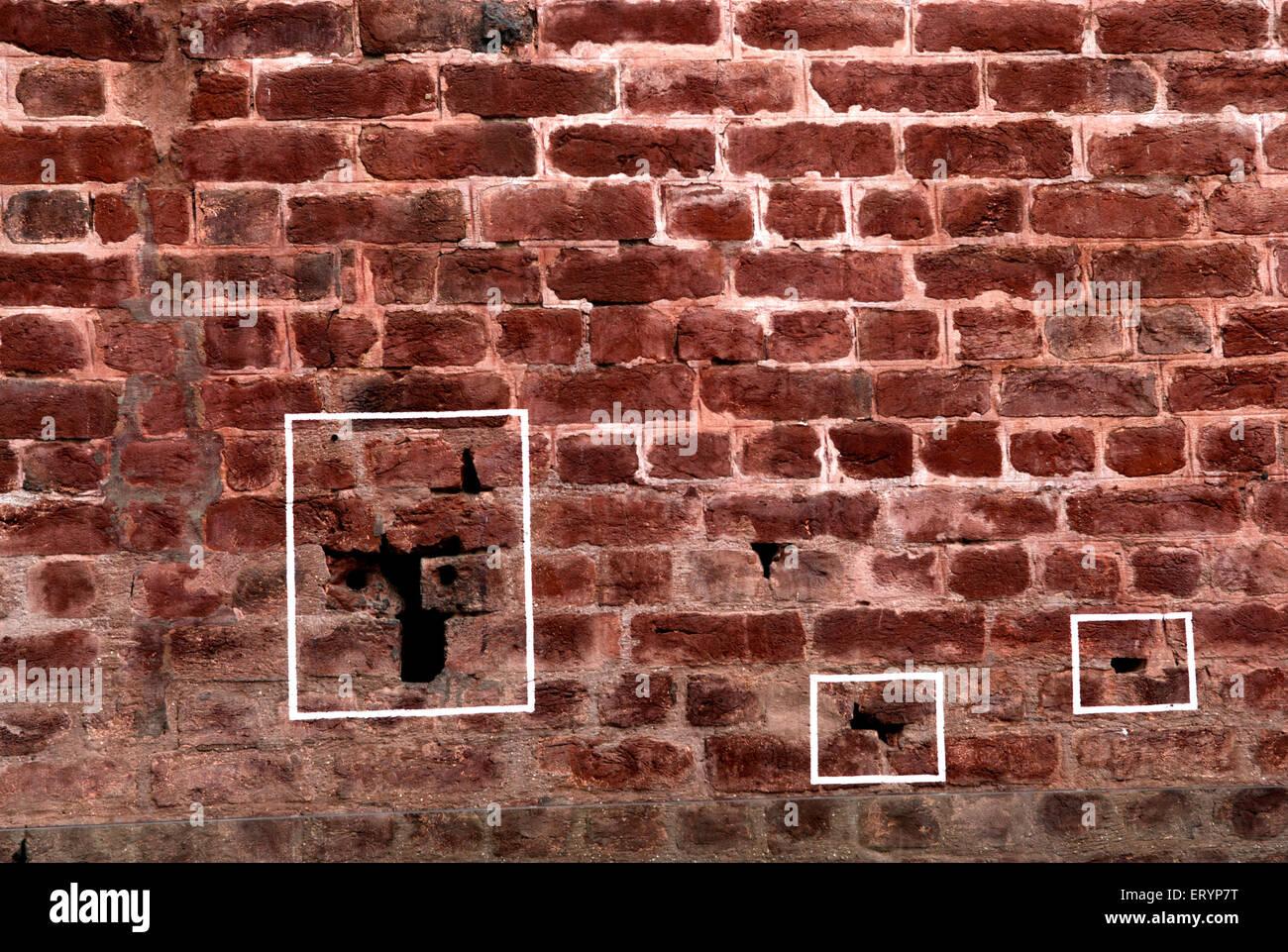 Bullet marks visible on preserved wall at Jallianwala or Jalianwala Bagh ; Amritsar ; Punjab ; India Stock Photo