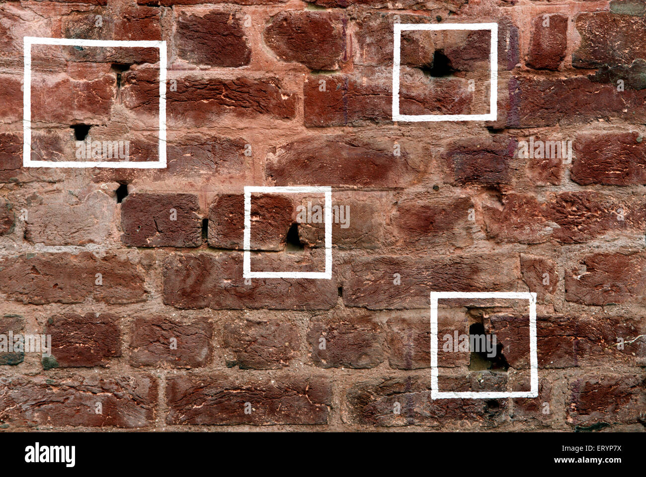 Bullet marks visible on preserved wall at Jallianwala or Jalianwala Bagh ; Amritsar ; Punjab ; India Stock Photo
