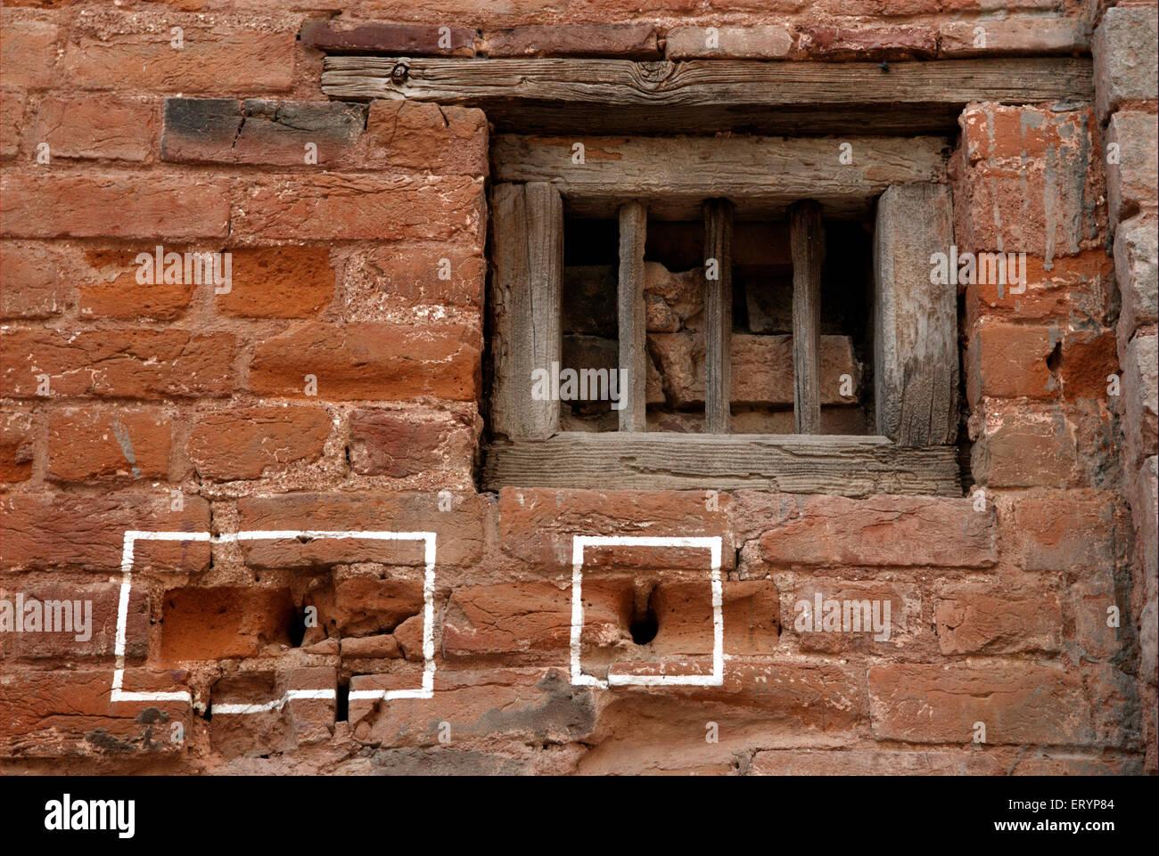 Bullet marks visible on preserved wall at Jallianwala or Jalianwala Bagh ; Amritsar ; Punjab ; India - Stock Image