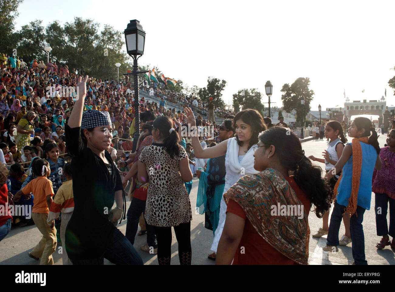 Audience dance on patriotic tunes before evening retreat ceremony called lowering flag at India Pakistan international - Stock Image