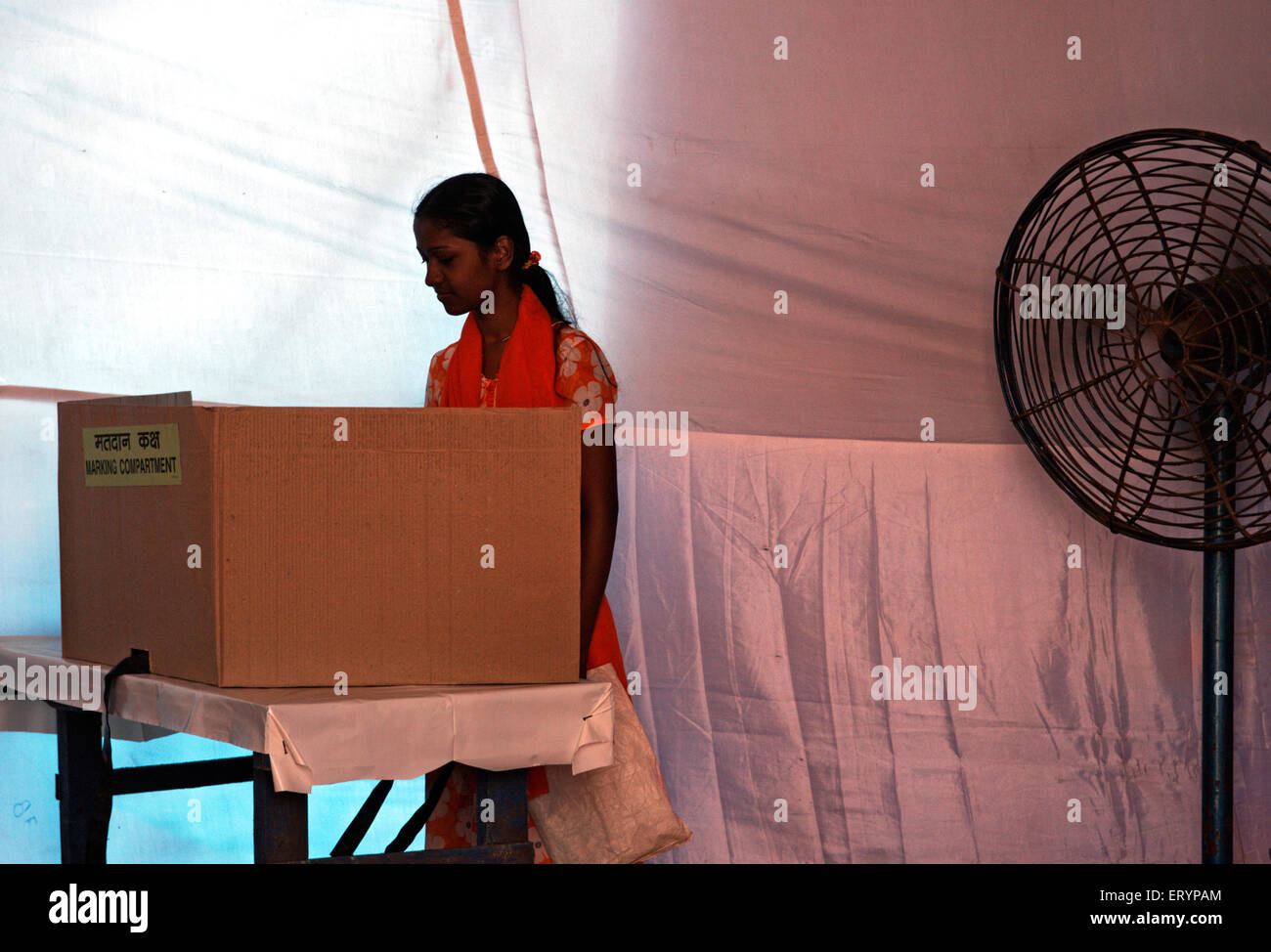Voter casting her vote in elections ; Bombay Mumbai ; Maharashtra ; India NO MR 30 April 2009 - Stock Image