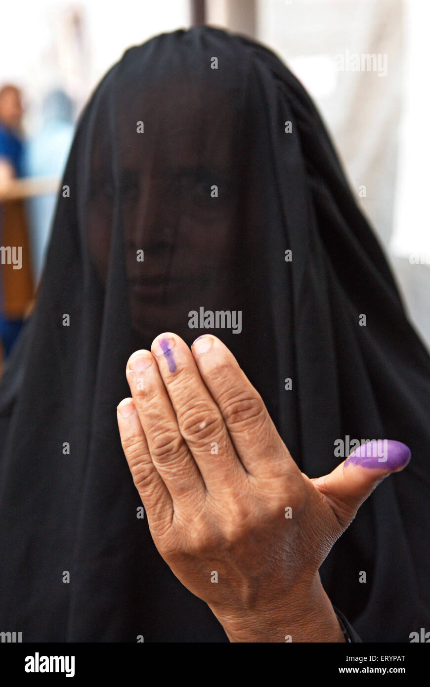 Muslim woman showing voting mark in elections ; Bombay Mumbai ; Maharashtra ; India 30 April 2009 NO MR - Stock Image