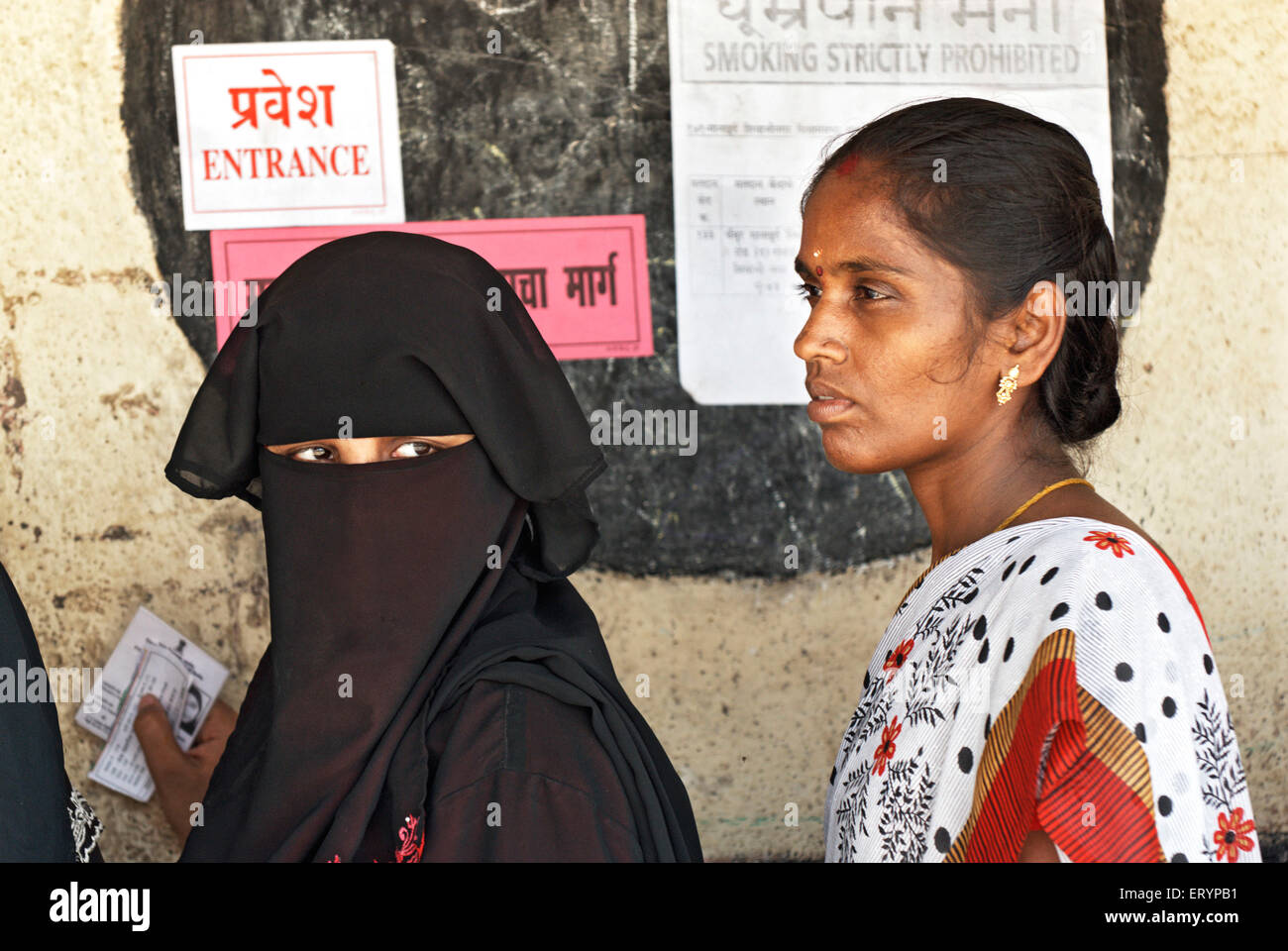 Hindu and Muslim women standing in queue to casting vote in elections Bombay Mumbai  ; Maharashtra  ; India NO MR - Stock Image
