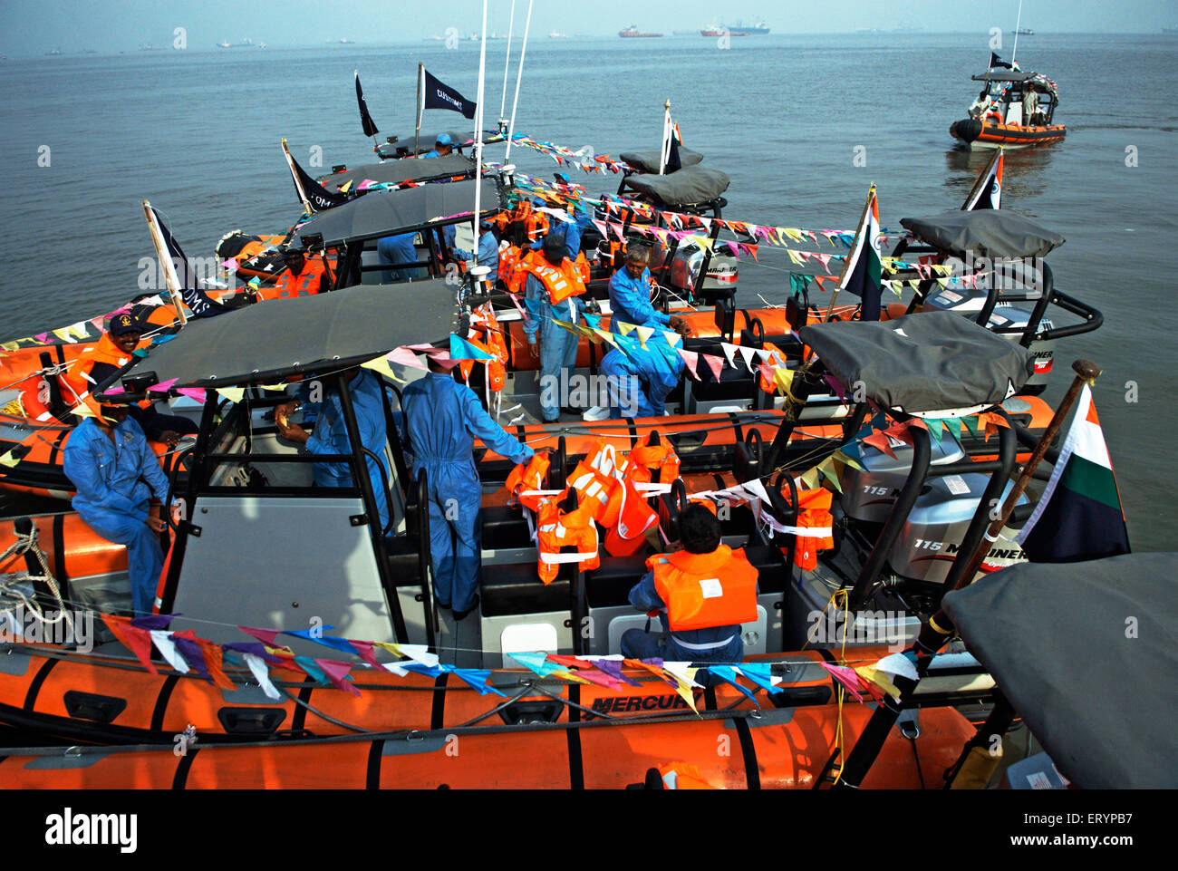 Customs employee checking boats inducted in their fleet for security in Bombay Mumbai  ; Maharashtra  ; India 13 - Stock Image
