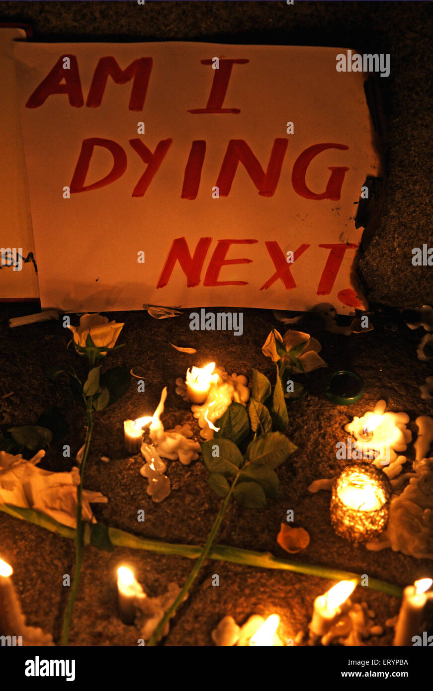 Condolences to terror attack victims by lighting candles and putting message across Bombay  ; Mumbai - Stock Image