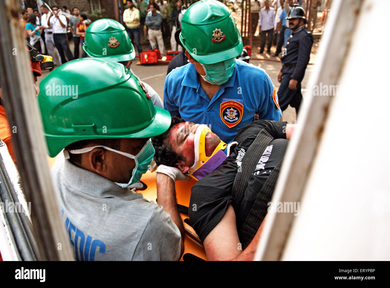Fire brigade personnel demonstrate emergency rescue skill for KEM college students in Bombay - Stock Image