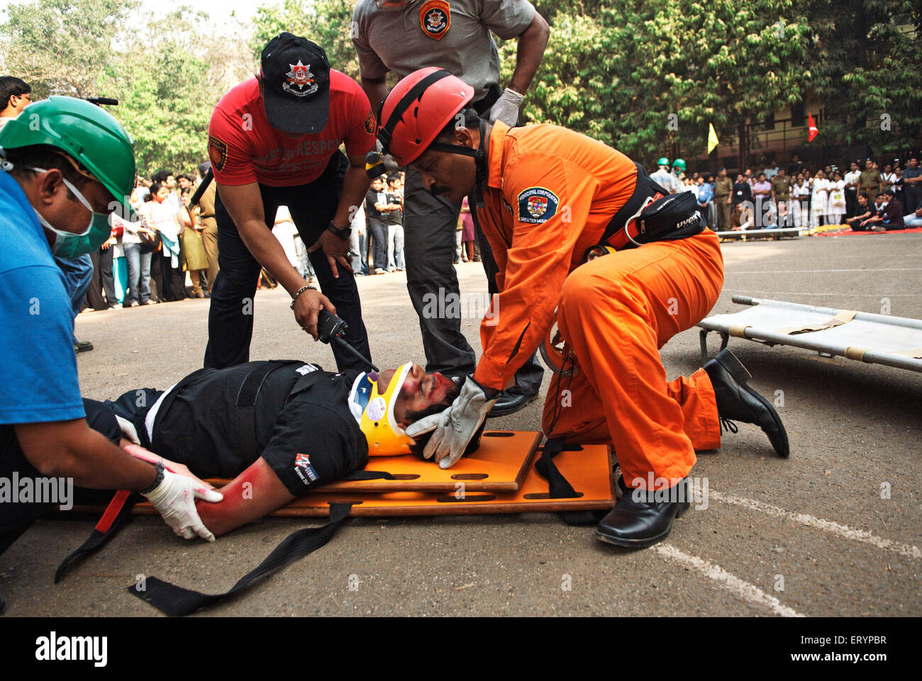 Fire brigade personnel demonstrate emergency rescue skill for KEM college students in Bombay Mumbai - Stock Image