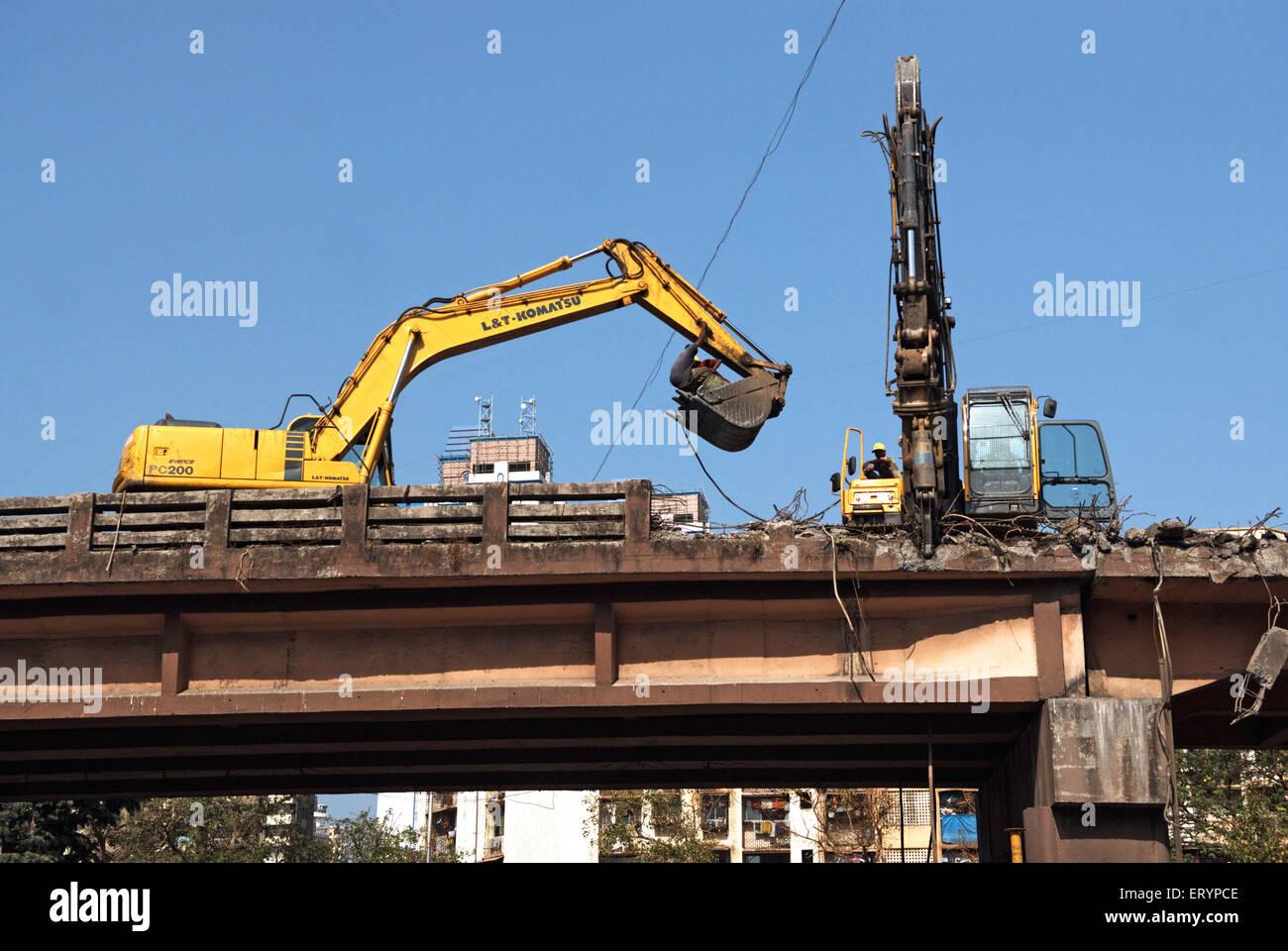 Demolishing lalbaug flyover using heavy machinery in Bombay Mumbai  ; Maharashtra  ; India 5 May 2009 - Stock Image