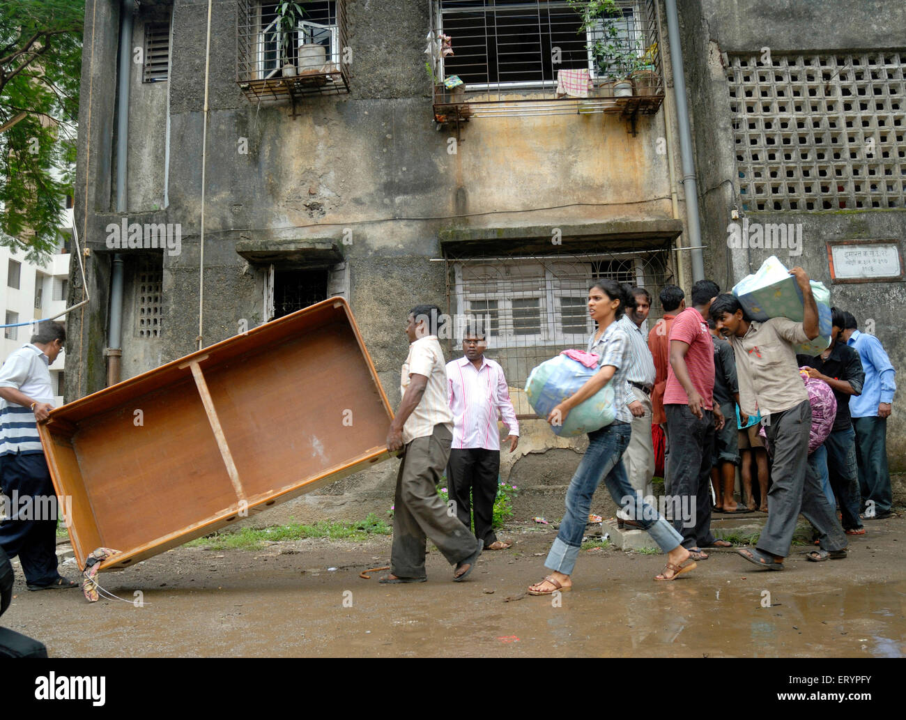 Residents vacate adjacent building after twenty five years old building collapsed after it developed cracks in Mulund - Stock Image