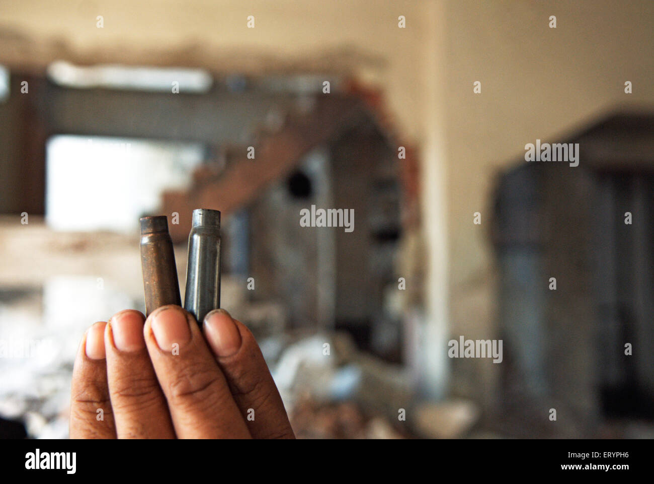 Man shows bullets in crossfire at nariman house jewish community centre by deccan mujahedeen terrorists attack in - Stock Image