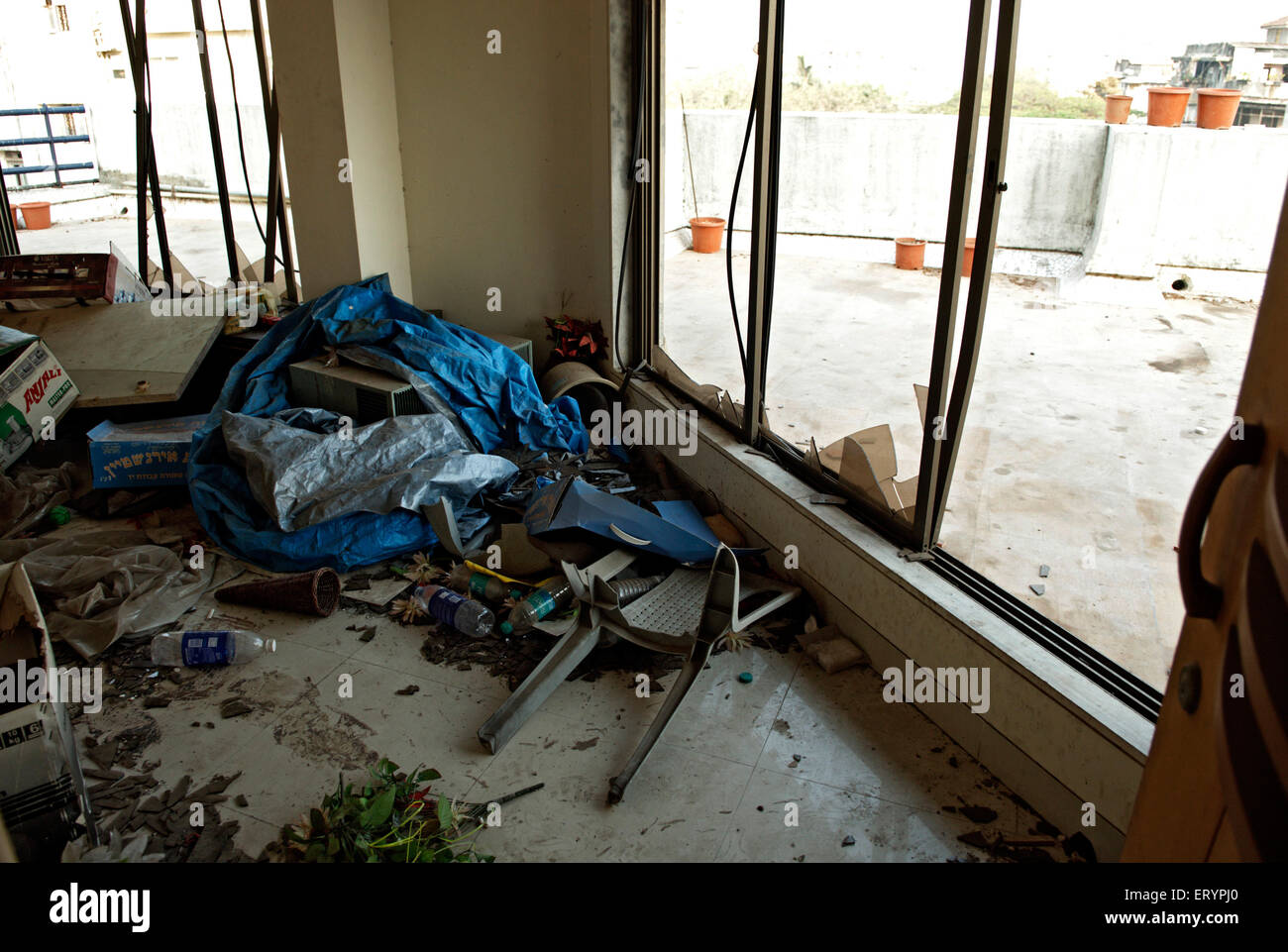 Broken window on terrace of nariman house jewish community centre by deccan mujahedeen terrorists attack in Bombay - Stock Image
