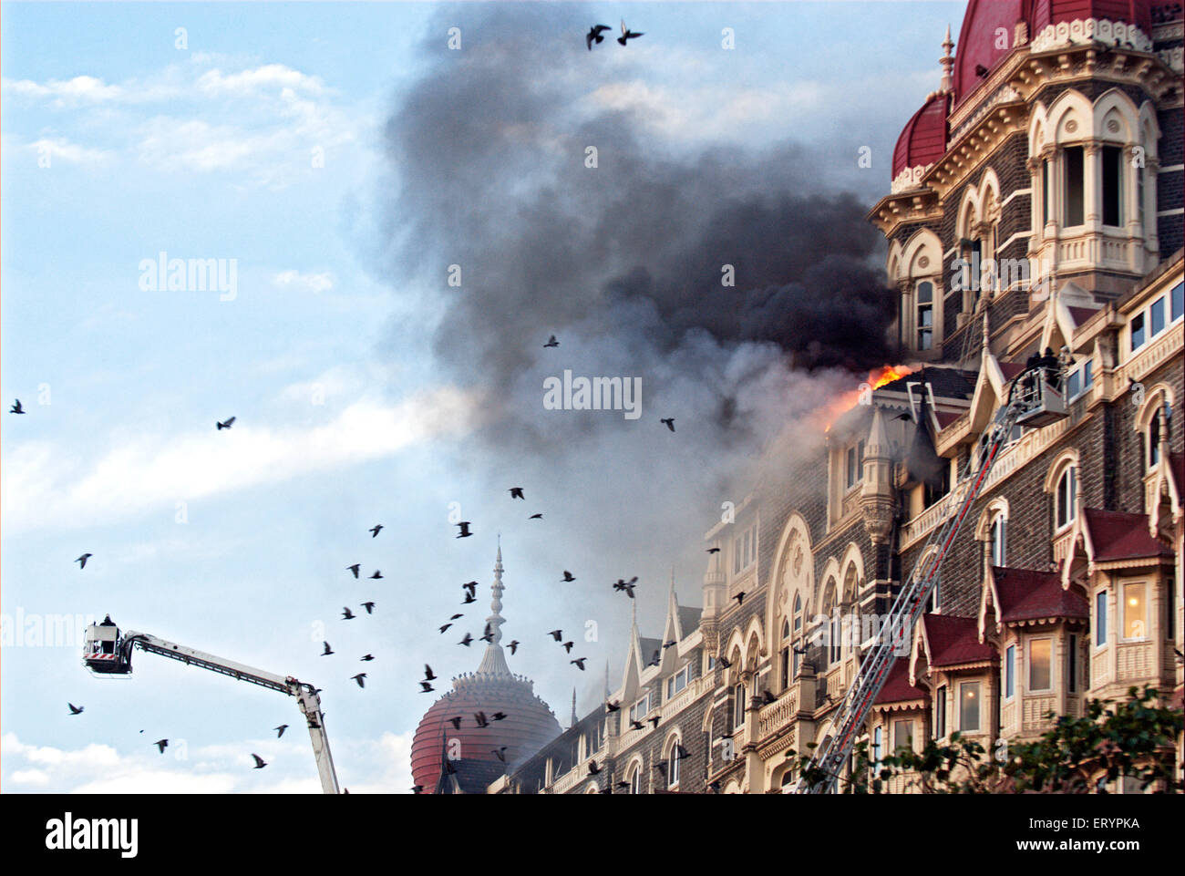 Fire fighters try to douse fire inside of Taj Mahal hotel after terrorist attack by deccan mujahedeen Bombay - Stock Image