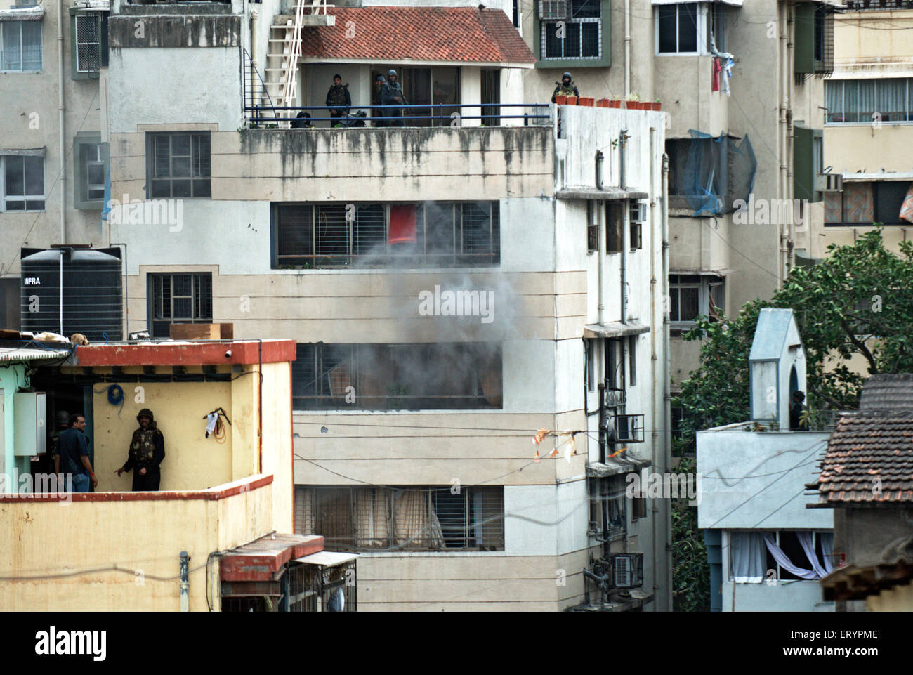 Grenade blast from nariman house after terrorist attack by deccan mujahedeen ; Bombay Mumbai - Stock Image
