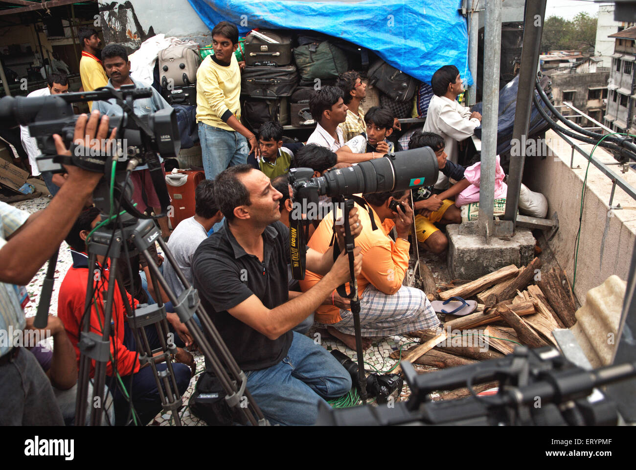 Press photographers and TV cameraman at nariman house after terrorist attack by mujahedeen ; Bombay Mumbai - Stock Image
