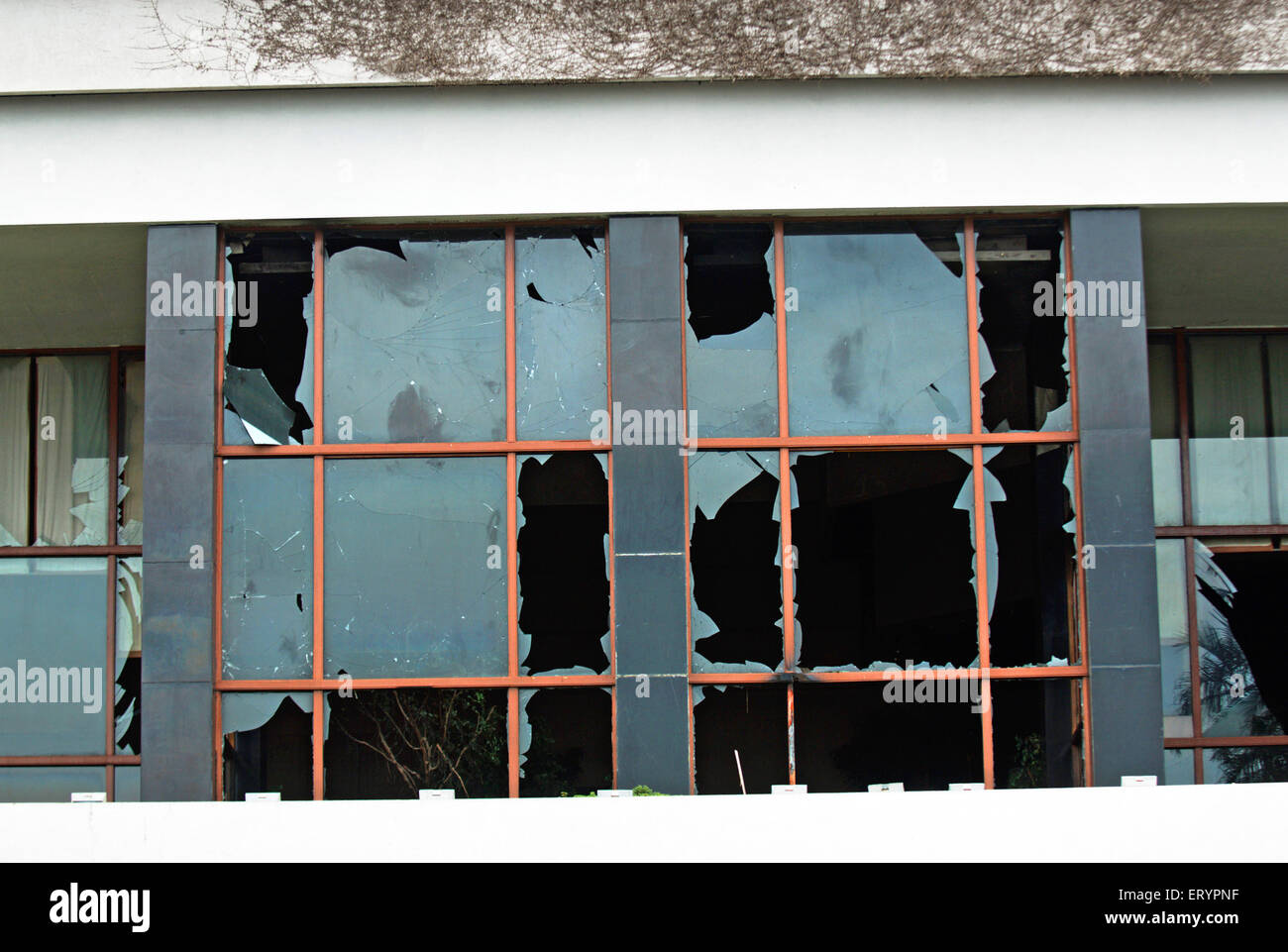 Shattered windscreens of hotel Trident after terrorist attack by deccan mujahedeen ; Bombay Mumbai - Stock Image