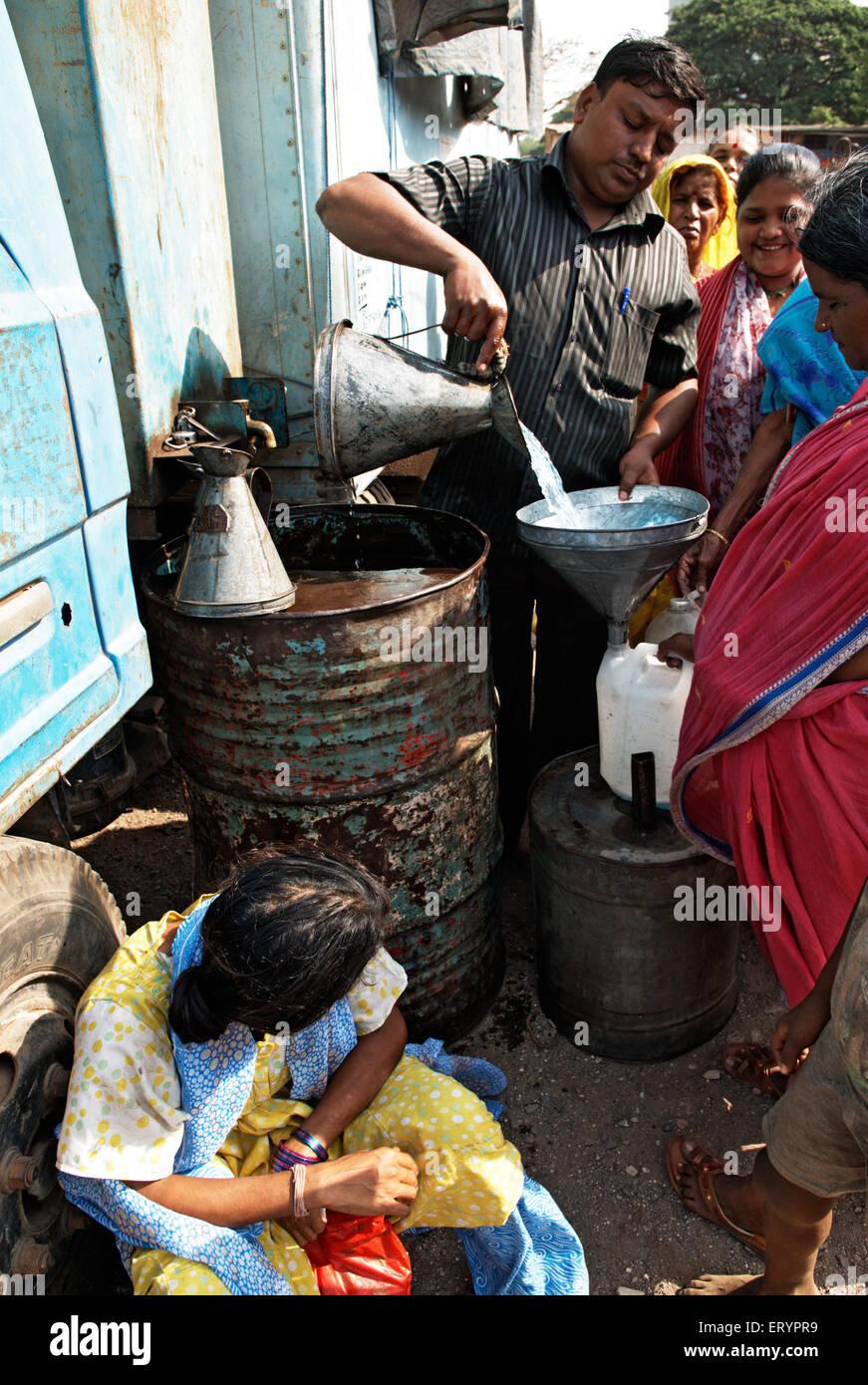 Kerosene distributed in ration shop in Bombay Mumbai  ; Maharashtra  ; India 17 April 2009 NO MR - Stock Image