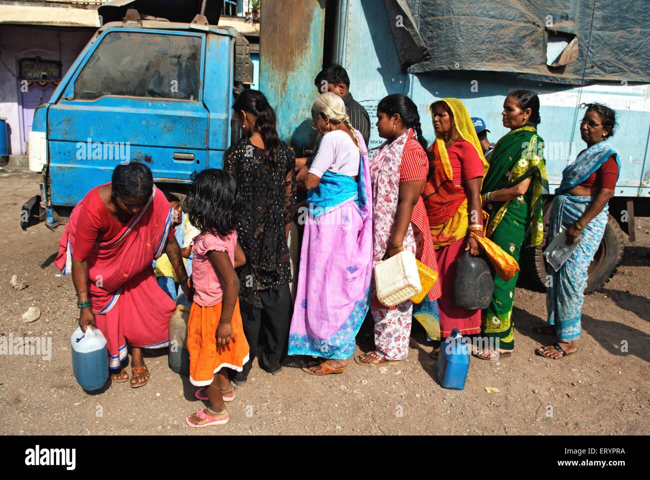 ladies queued up for kerosene distributed in ration shop in Bombay Mumbai  ; Maharashtra  ; India 17 April 2009 - Stock Image