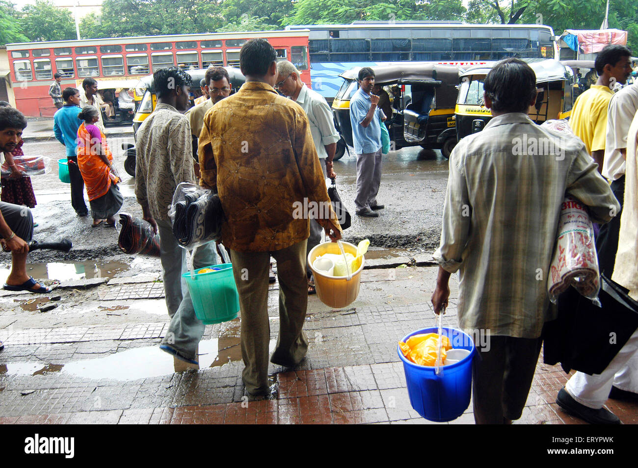 Local poor residents get relief materials in Ghatkopar ; Bombay Mumbai ; Maharashtra ; India 26 July 2005 - Stock Image