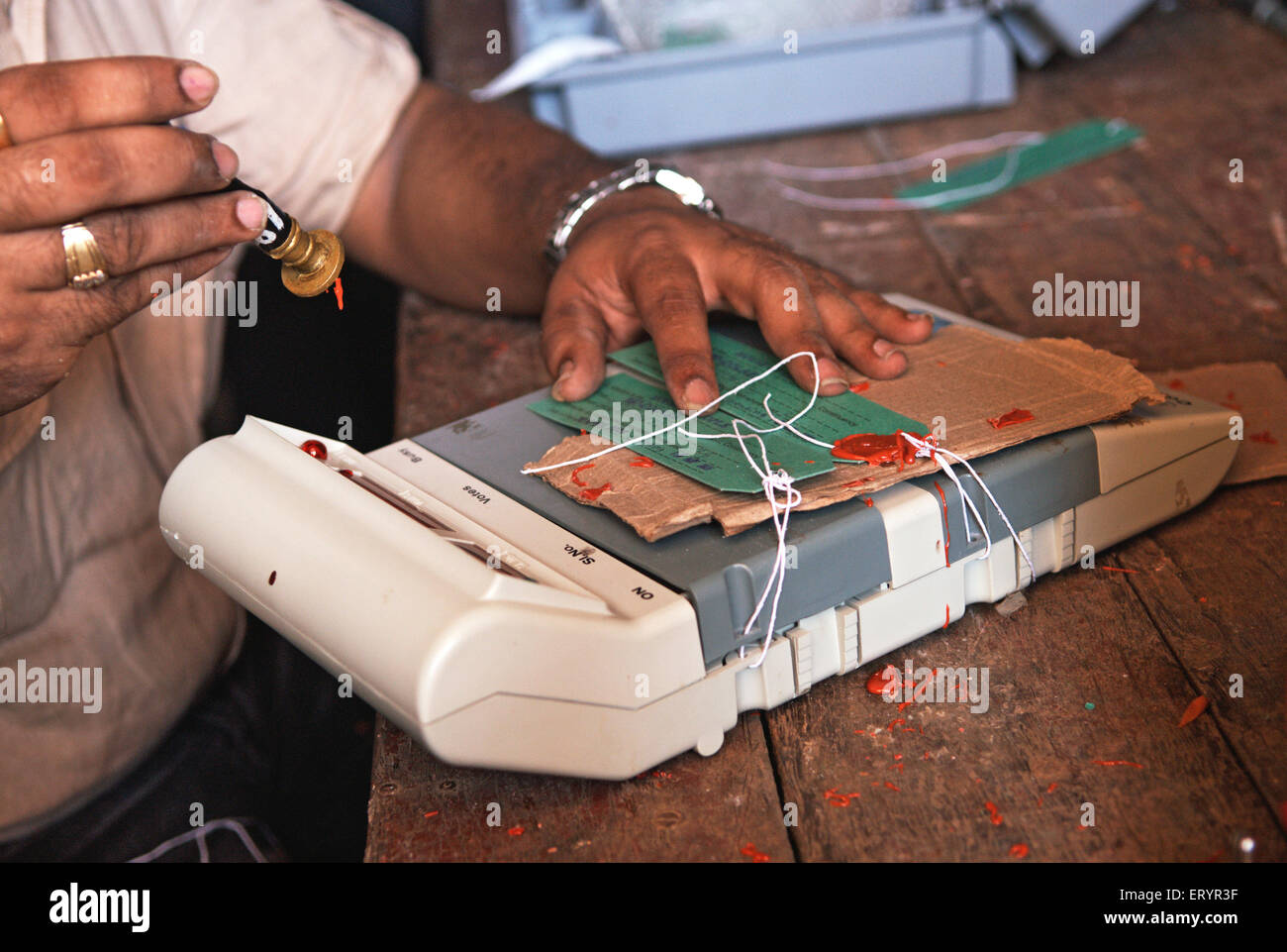Government staff put election commission seal on control unit of electronic voting machine ; Bombay - Stock Image
