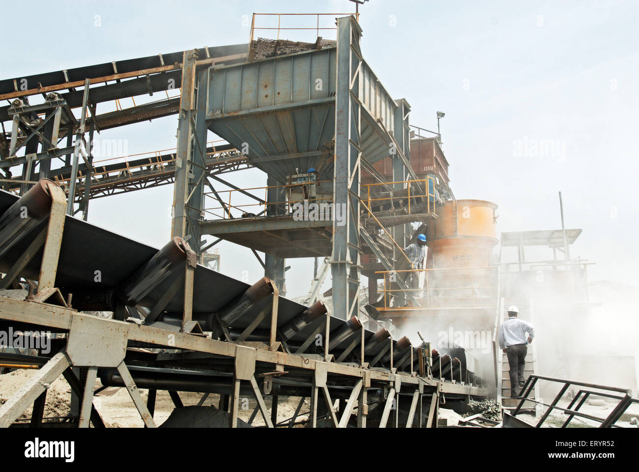 Workers and engineer monitoring stone crushing plant on bypass site ; Madras Chennai ; Tamil Nadu ; India 17 July - Stock Image