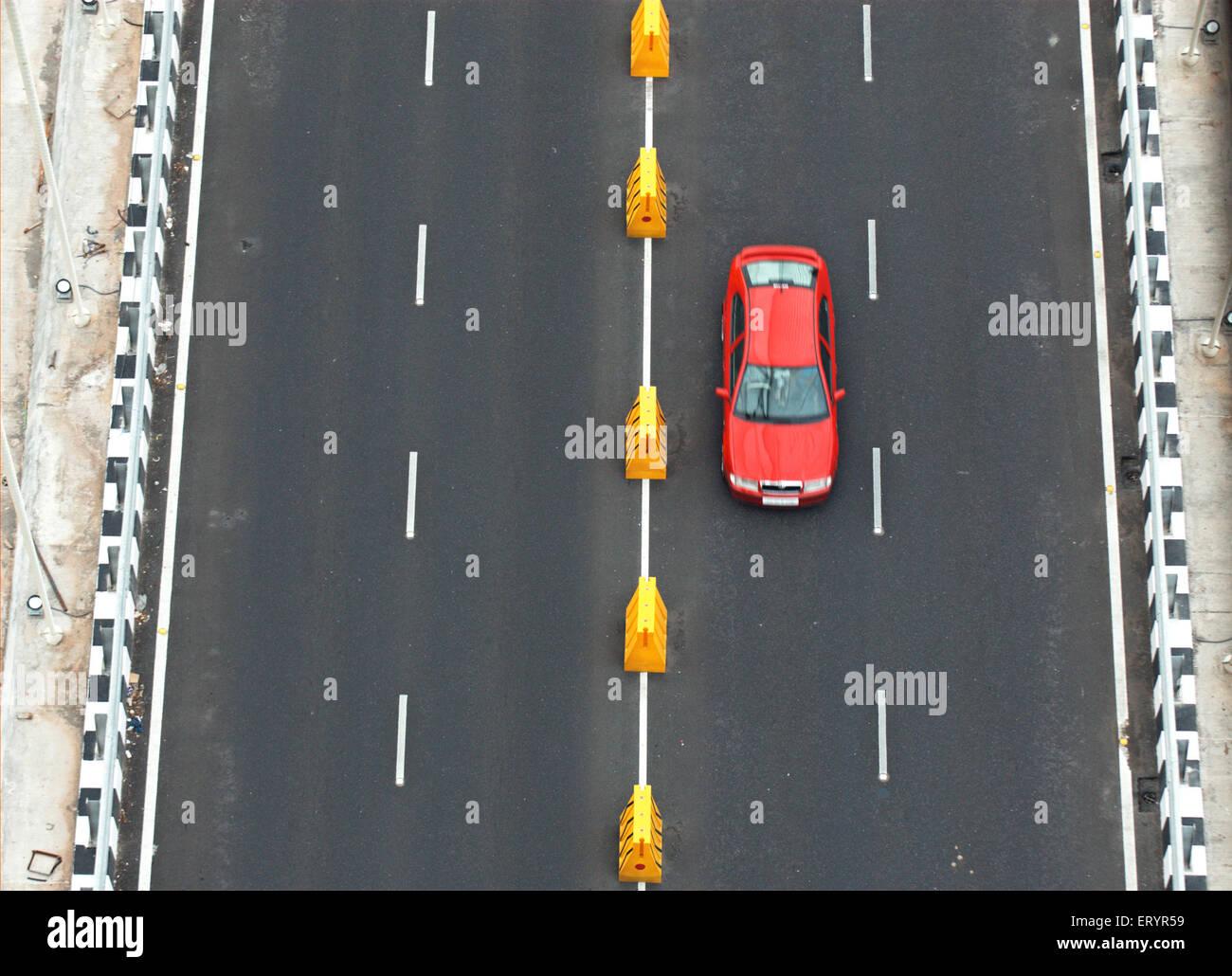 Car on twin carriageway of bandra worli known rajiv gandhi sea link ; Bombay Mumbai ; Maharashtra ; India 8 August - Stock Image