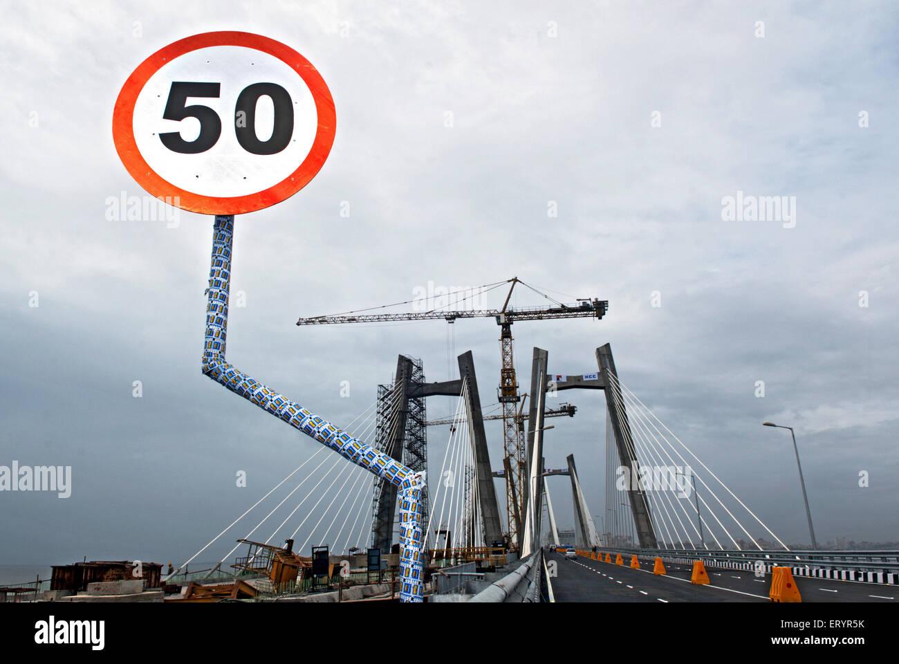 Board showing maximum speed limit on bandra worli known rajiv gandhi sea link ; Bombay Mumbai ; Maharashtra ; India - Stock Image