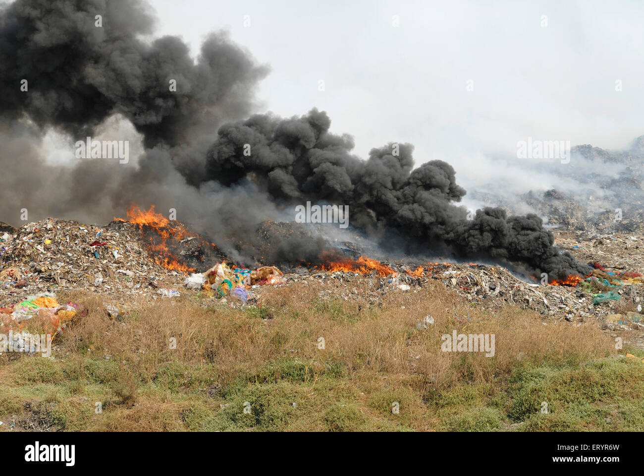 Burning garbage in dumping ground ; Deonar ; Bombay Mumbai ; Maharashtra ; India - Stock Image