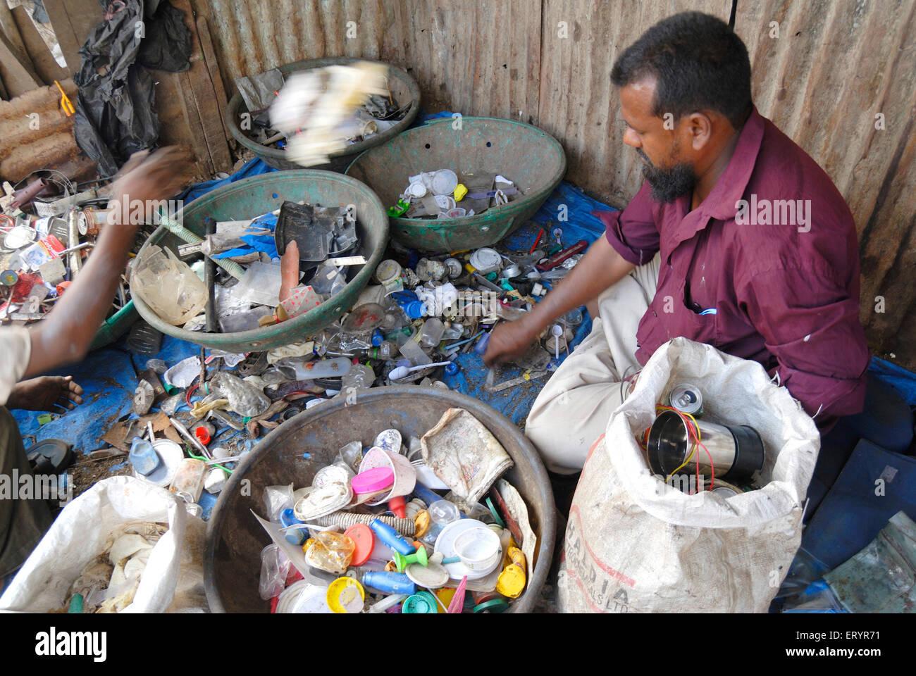 Scrap dealers sorting scrap ; Bombay Mumbai ; Maharashtra ; India - Stock Image