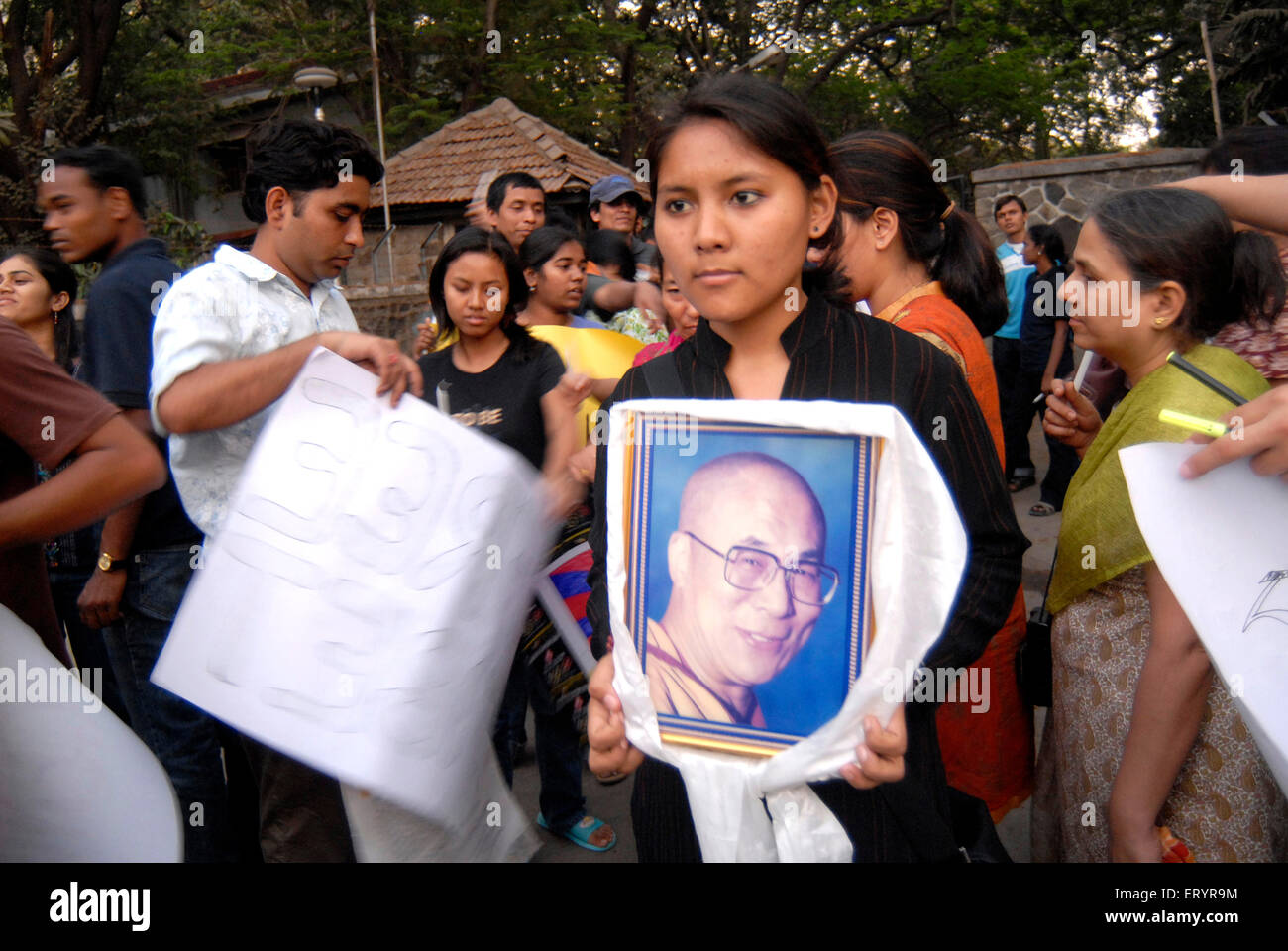 Tibetans holding photograph of Dalai Lama protesting against Chinese crackdown in Tibet ; Bombay - Stock Image