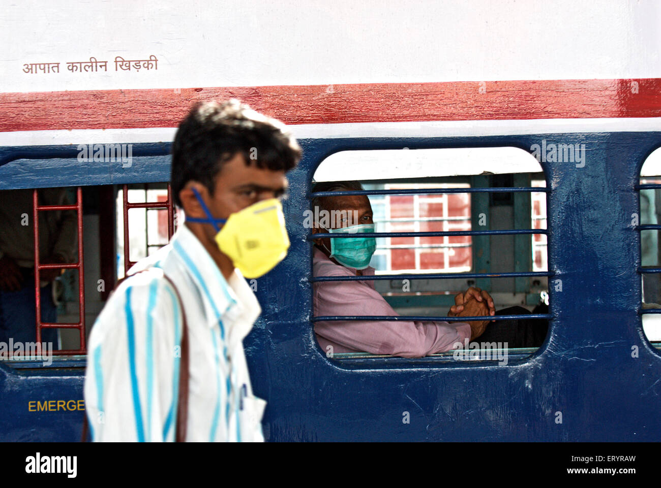Commuters covered face with mask protection from swine flu ; Bombay Mumbai ; Maharashtra ; India 12 August 2009 - Stock Image