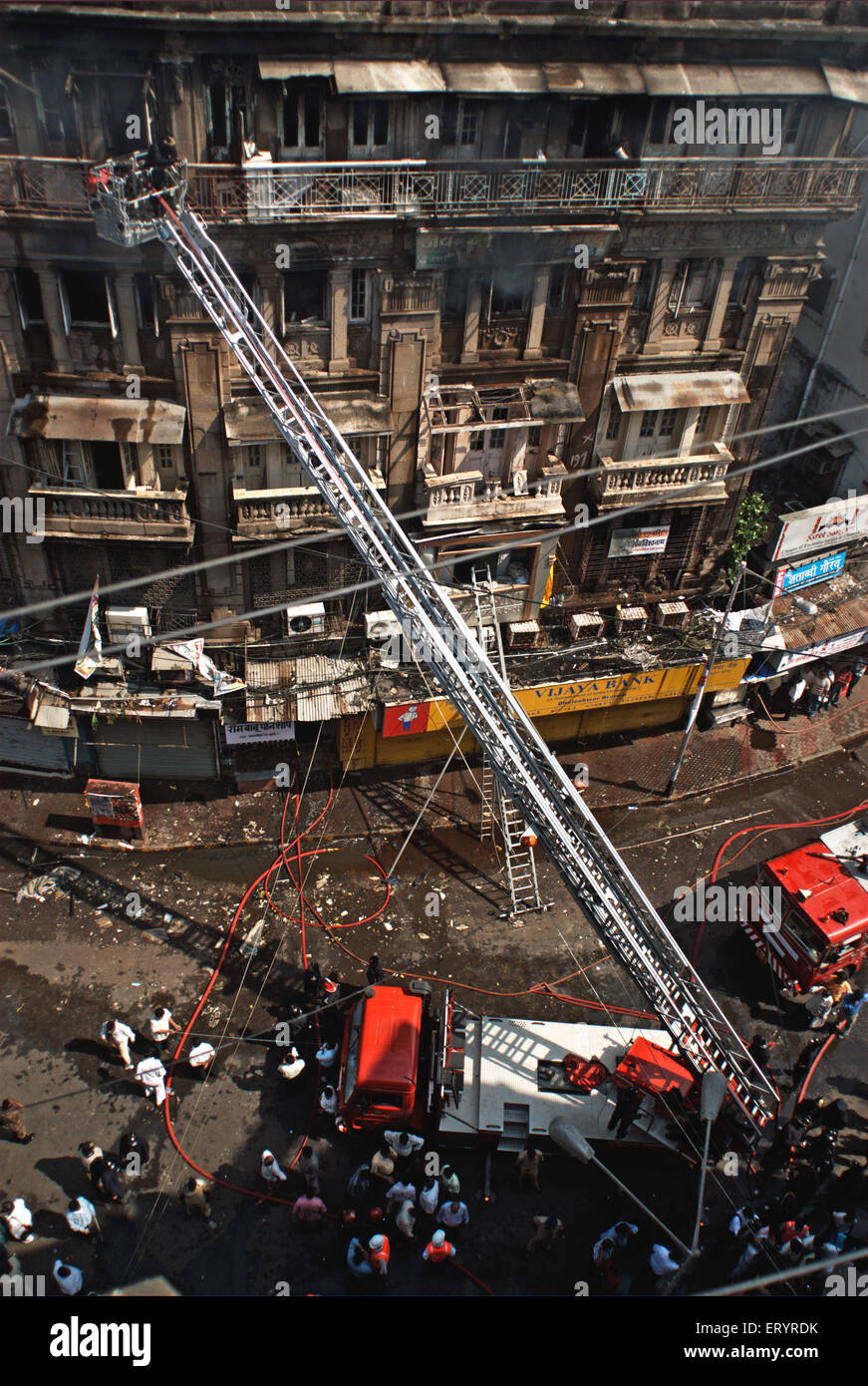 Fire tenders stands in narrow lane firemen try to douse fire in Johri Mansion at Kalbadevi ; Bombay Mumbai - Stock Image