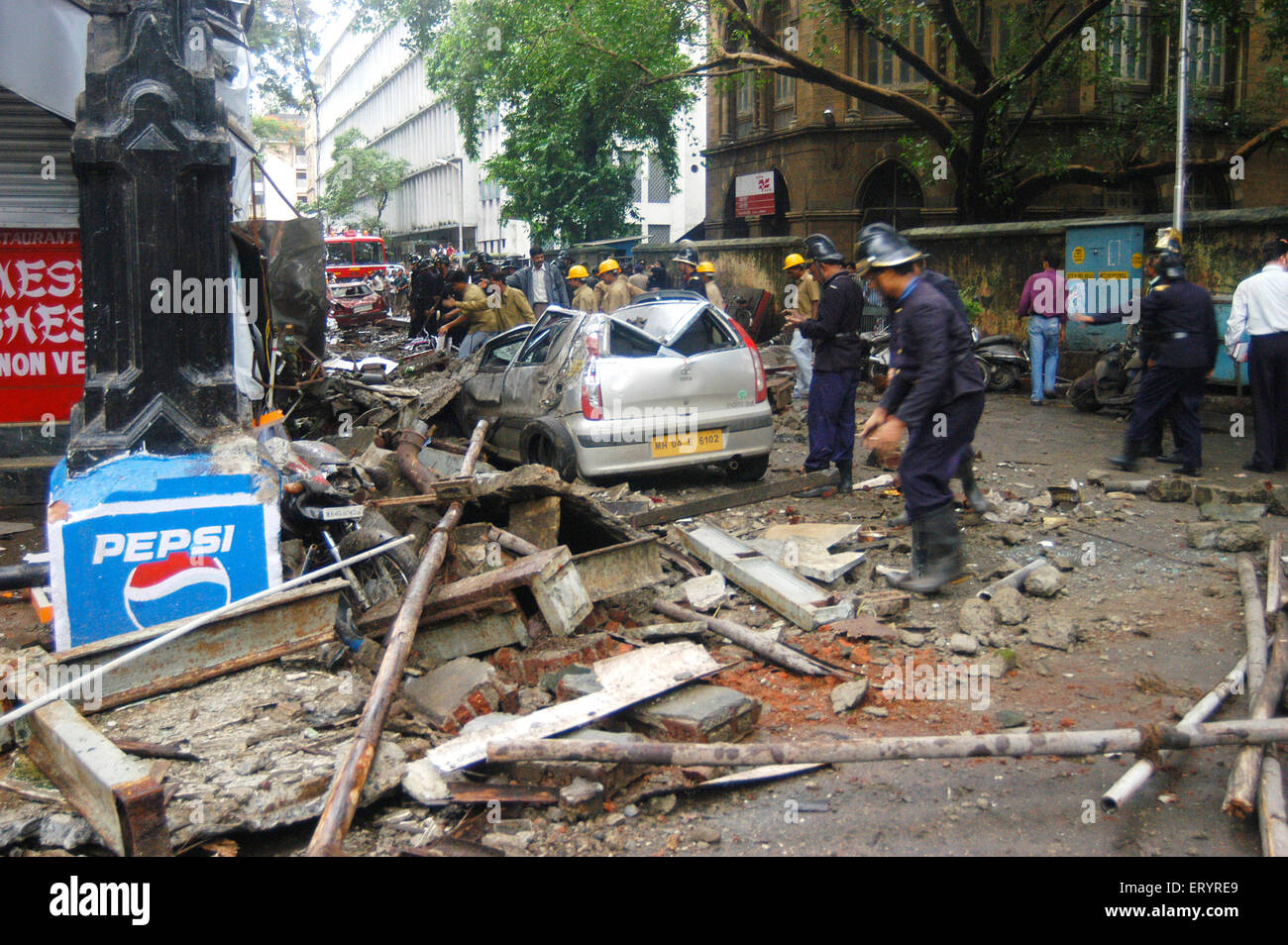 Fire brigade officers clear concrete debris fallen on vehicle part of heritage building Esplanade Mansion collapse - Stock Image
