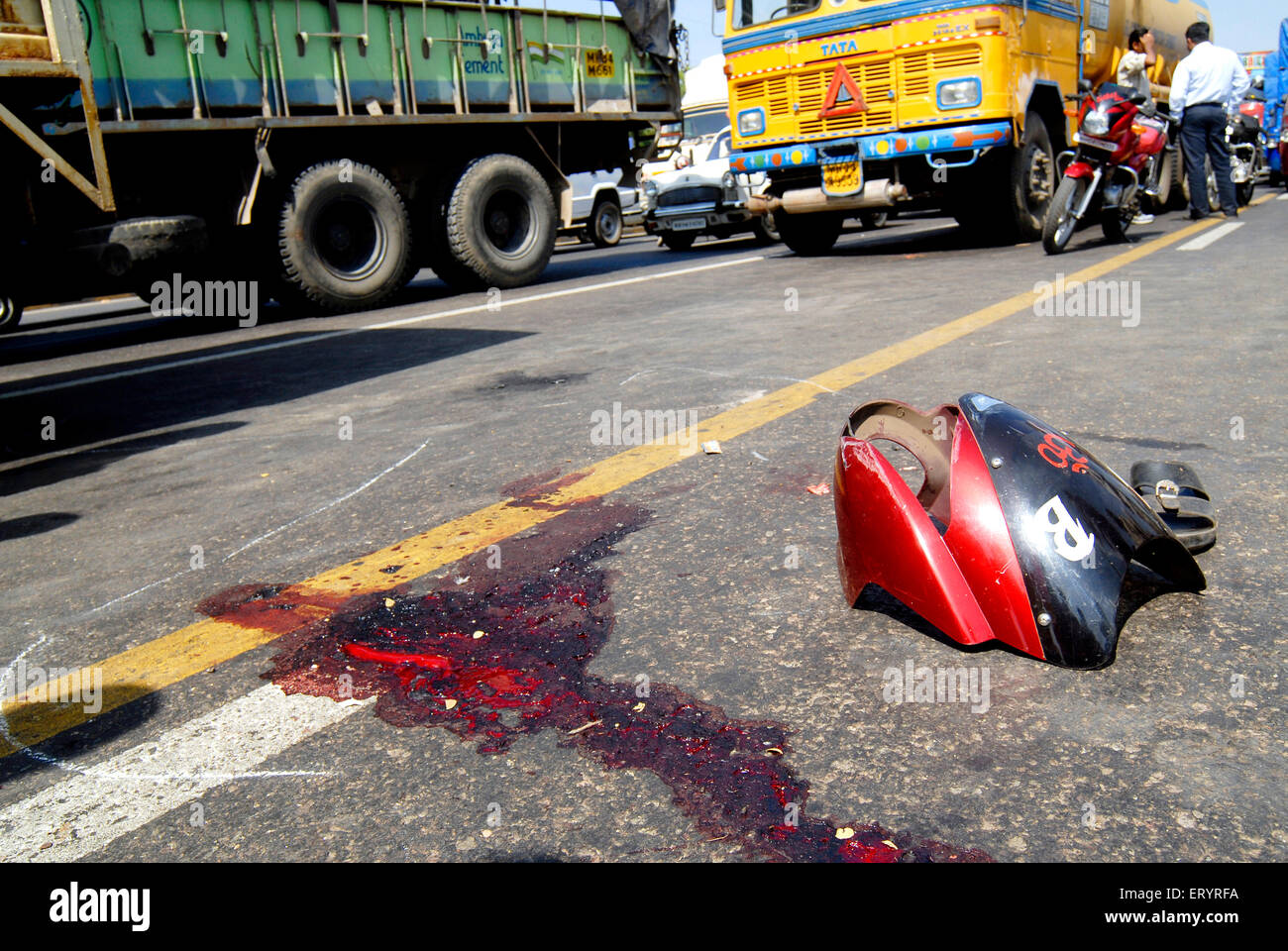 Blood and broken part of two wheeler accident on express highway in Bombay Mumbai ; Maharashtra ; India - Stock Image