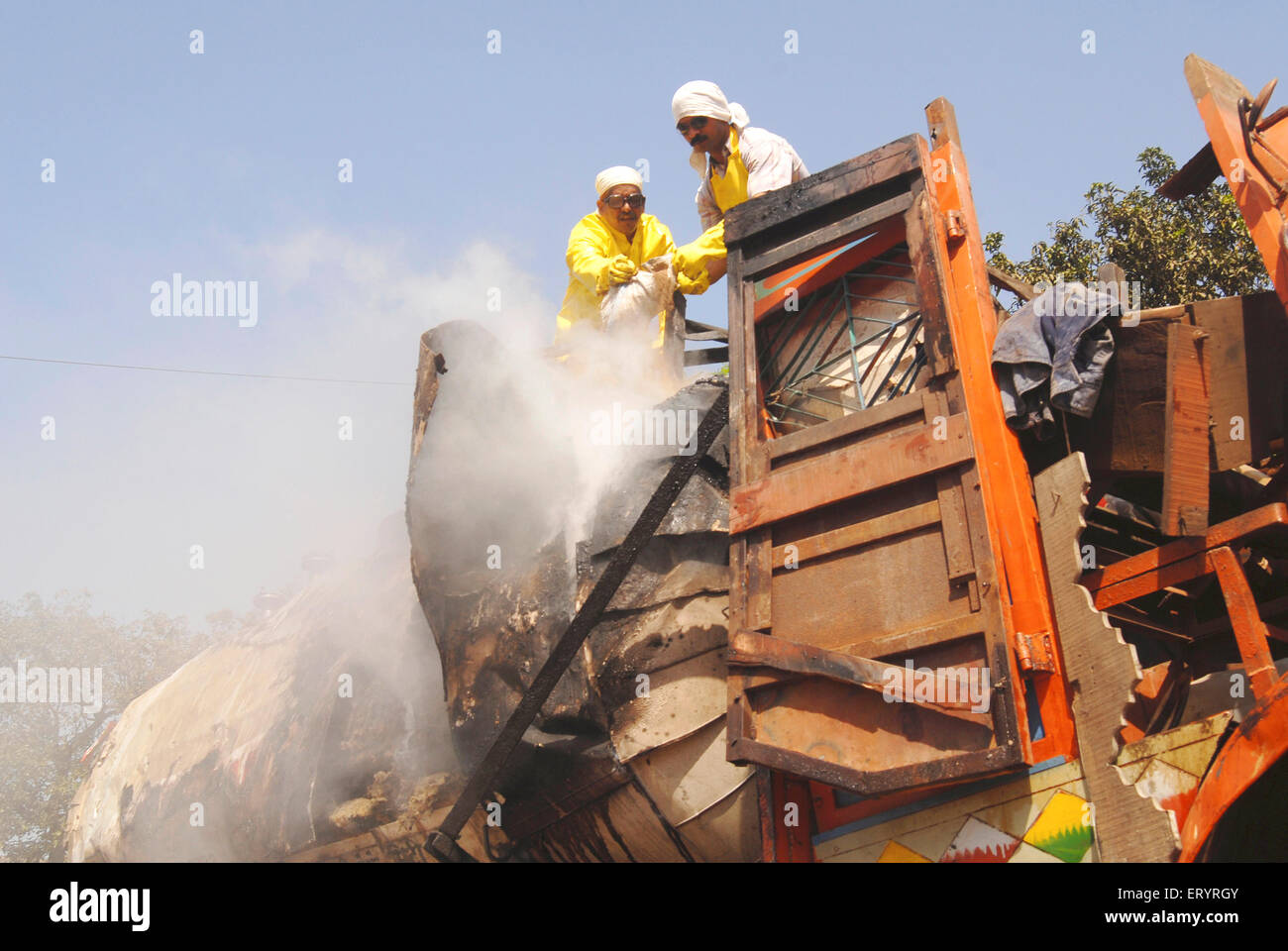 Fire department control chemical leak to prevent damage due to truck accident at Panvel ; Maharashtra ; India - Stock Image