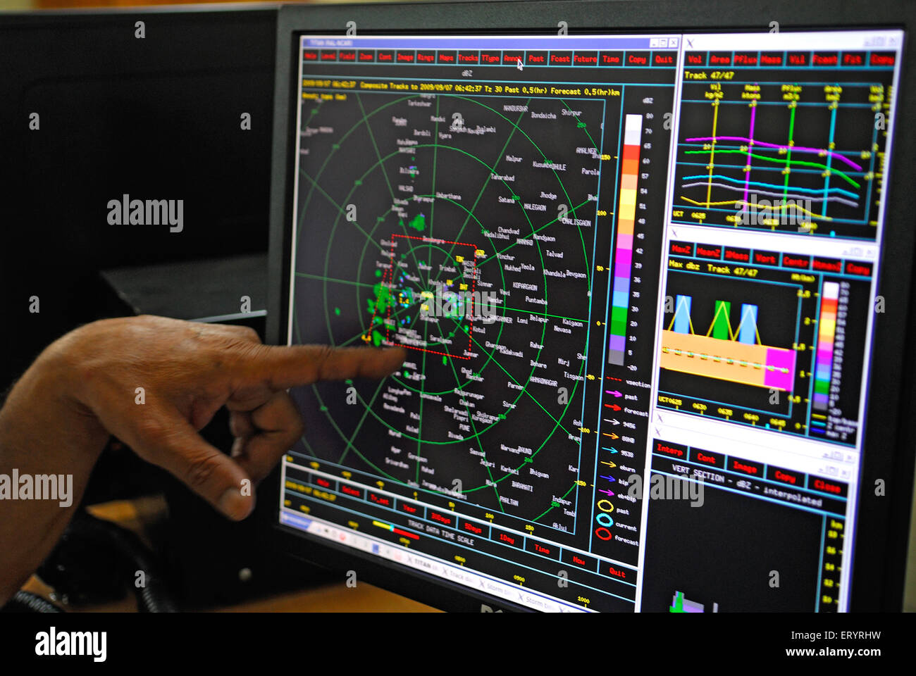 Operator showing mini air traffic control setup for air cloud seeding operation ; Maharashtra ; India 10 September - Stock Image