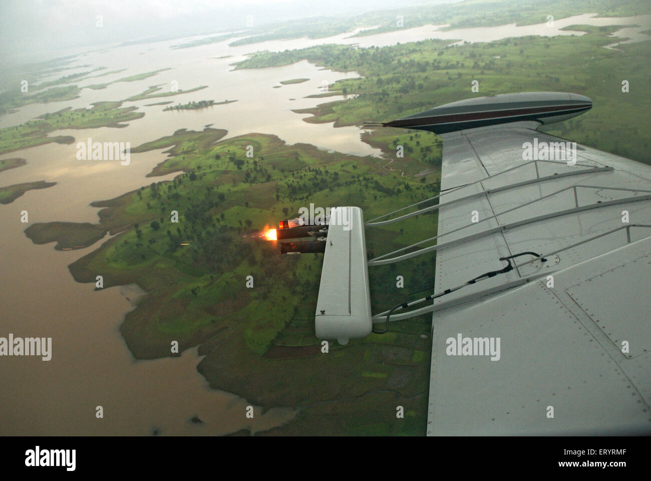 Cloud seeding by piper aircraft uppar vaitarana lake ; Nashik ; Maharashtra ; India - Stock Image