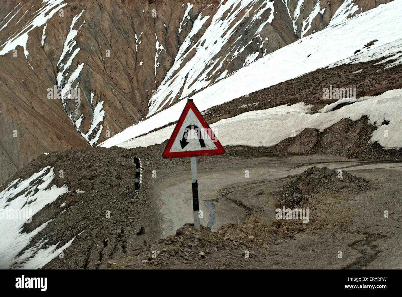 Left bend signboard on leh kargil road ; Ladakh ; Jammu and Kashmir ; India 9 April 2008 - Stock Image