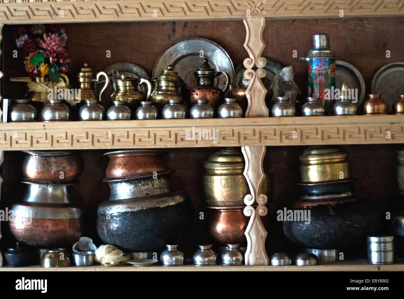 Utensils in wood cupboard ; Leh ; Ladakh ; Jammu and Kashmir ; India 9 April 2008 - Stock Image