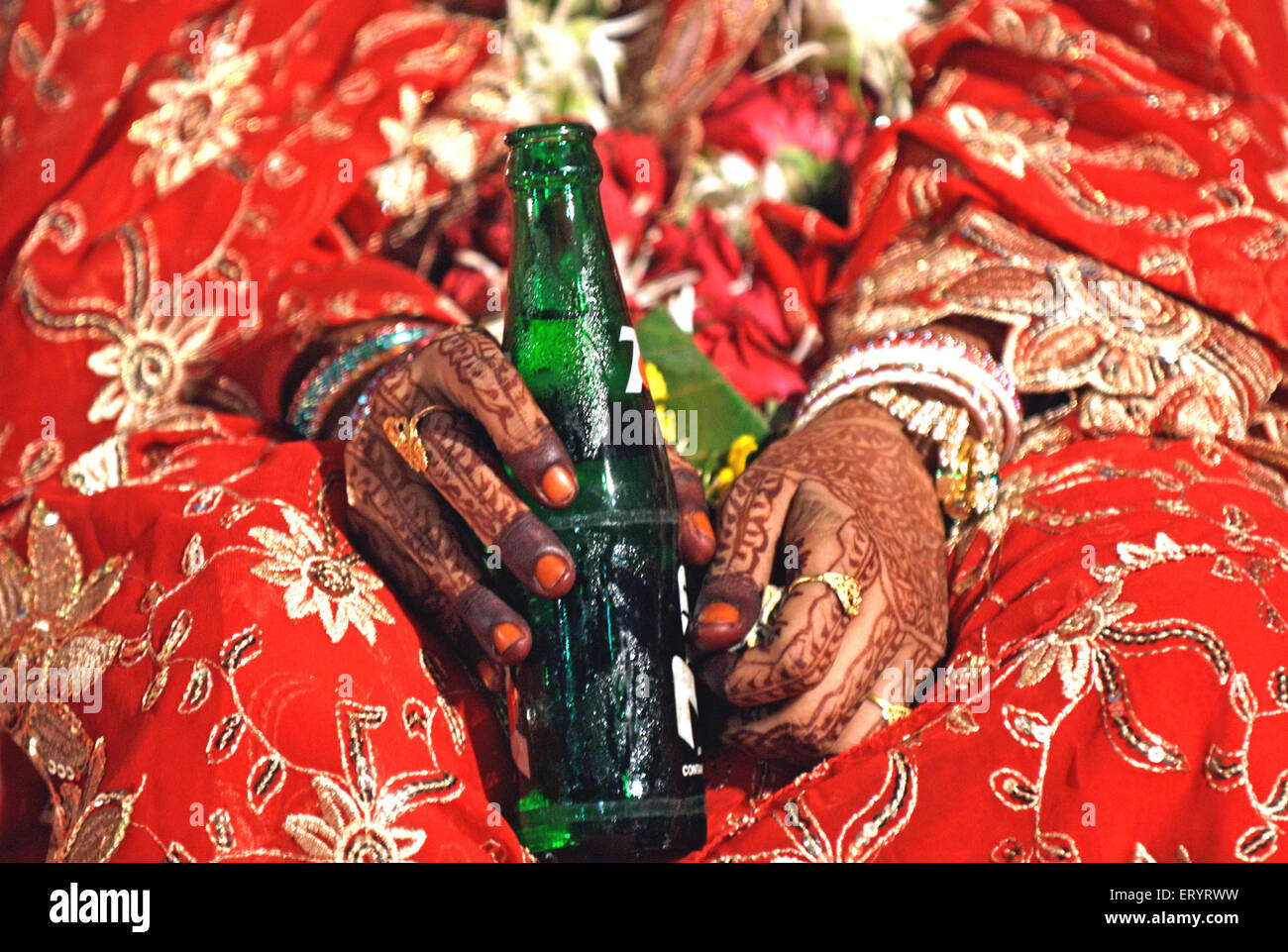 Muslim bride holding soft drink bottle in marriage ceremony 15 June 2009 - Stock Image